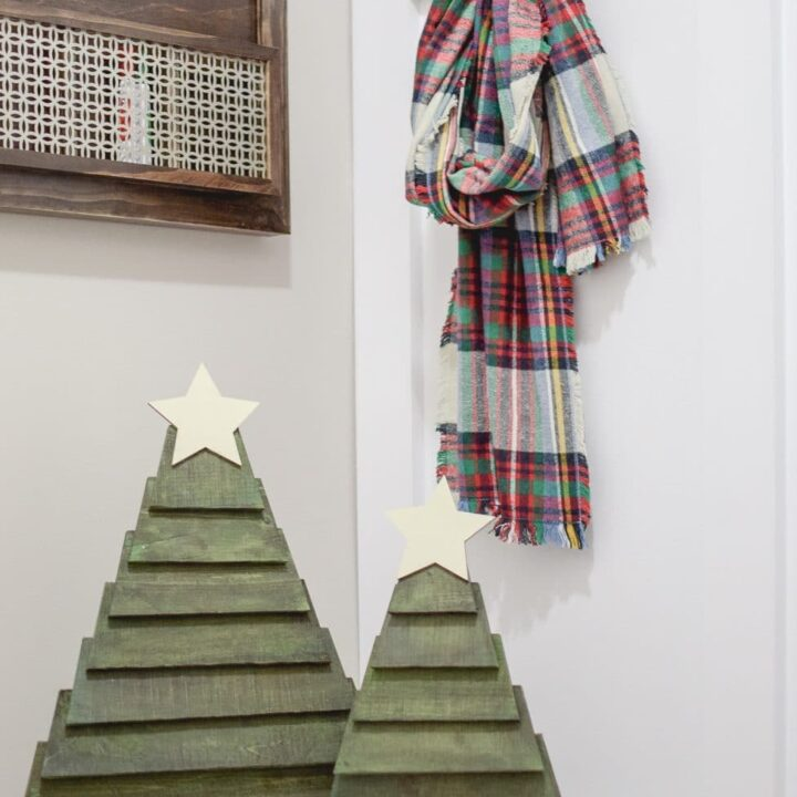 Make your own pallet Christmas trees quickly! You can paint them any color and add some fun decor! Click to see how to make them for yourself!