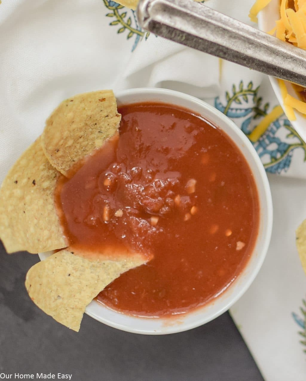 Chips and salsa is the perfect side to serve with this slow cooker tortilla soup recipe
