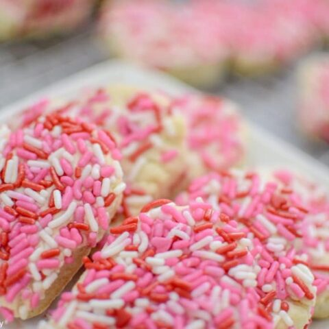 Super easy Valentine's Day cookies. They are soft and chewy and full of sprinkles! Click to see the sugar cookie recipe.