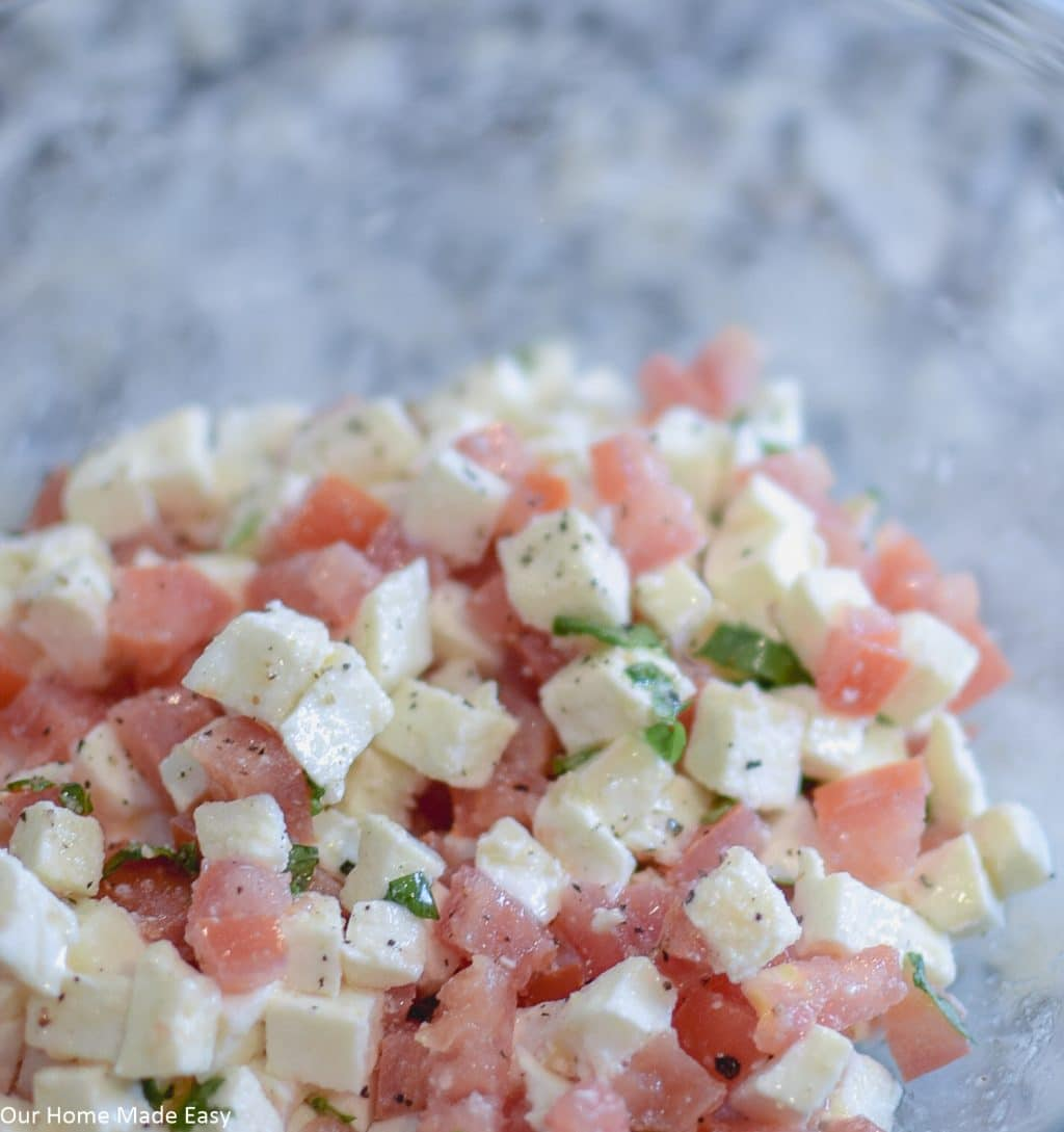This Caprese Bruschetta recipe has juicy diced tomatoes and creamy mozzarella cheese