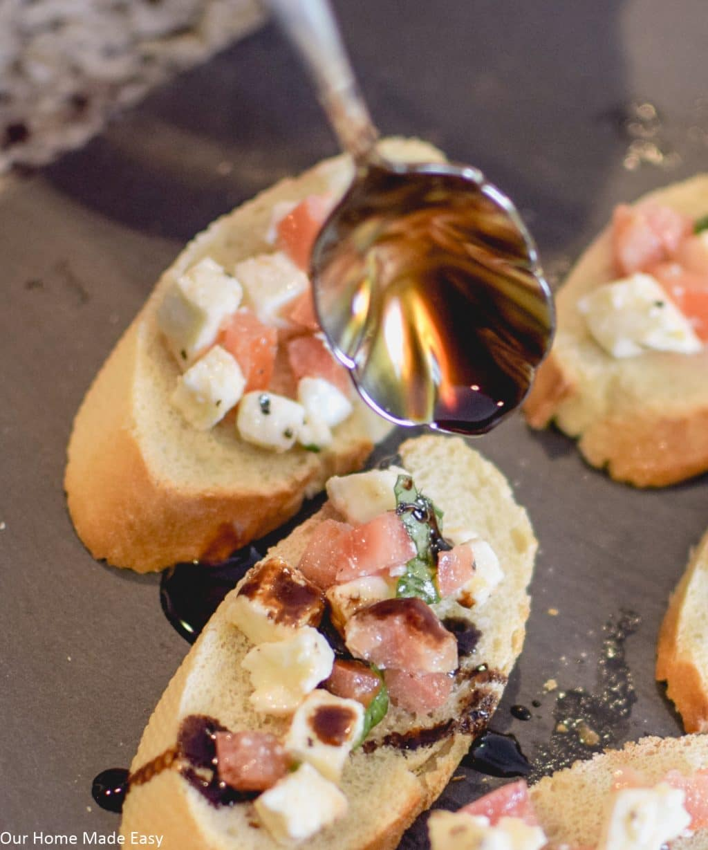 This super easy balsamic caprese bruschetta recipe is the BEST appetizer! Not only is it super quick to make, but it tastes so great, too