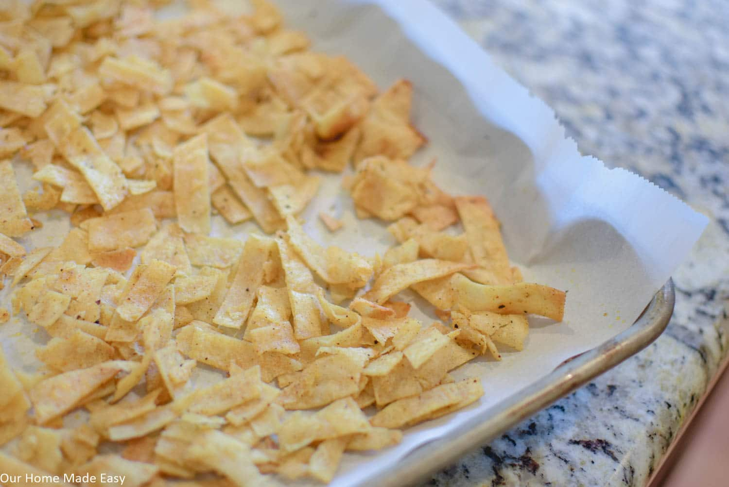 These homemade tortilla strips are perfect to add a little crunch to any kind of salad!