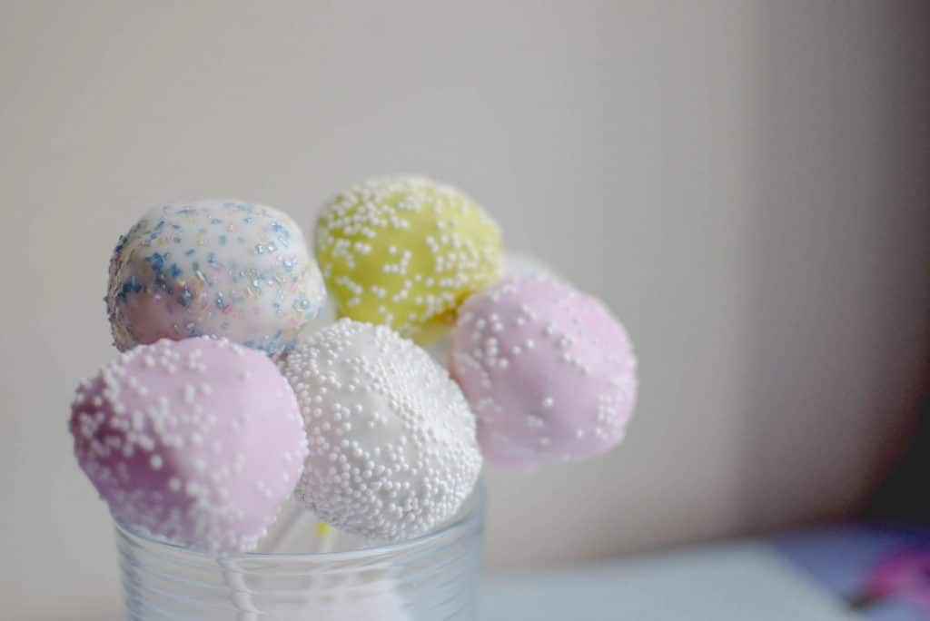 Once dipped, decorate your Easter cake pops with fun sprinkles