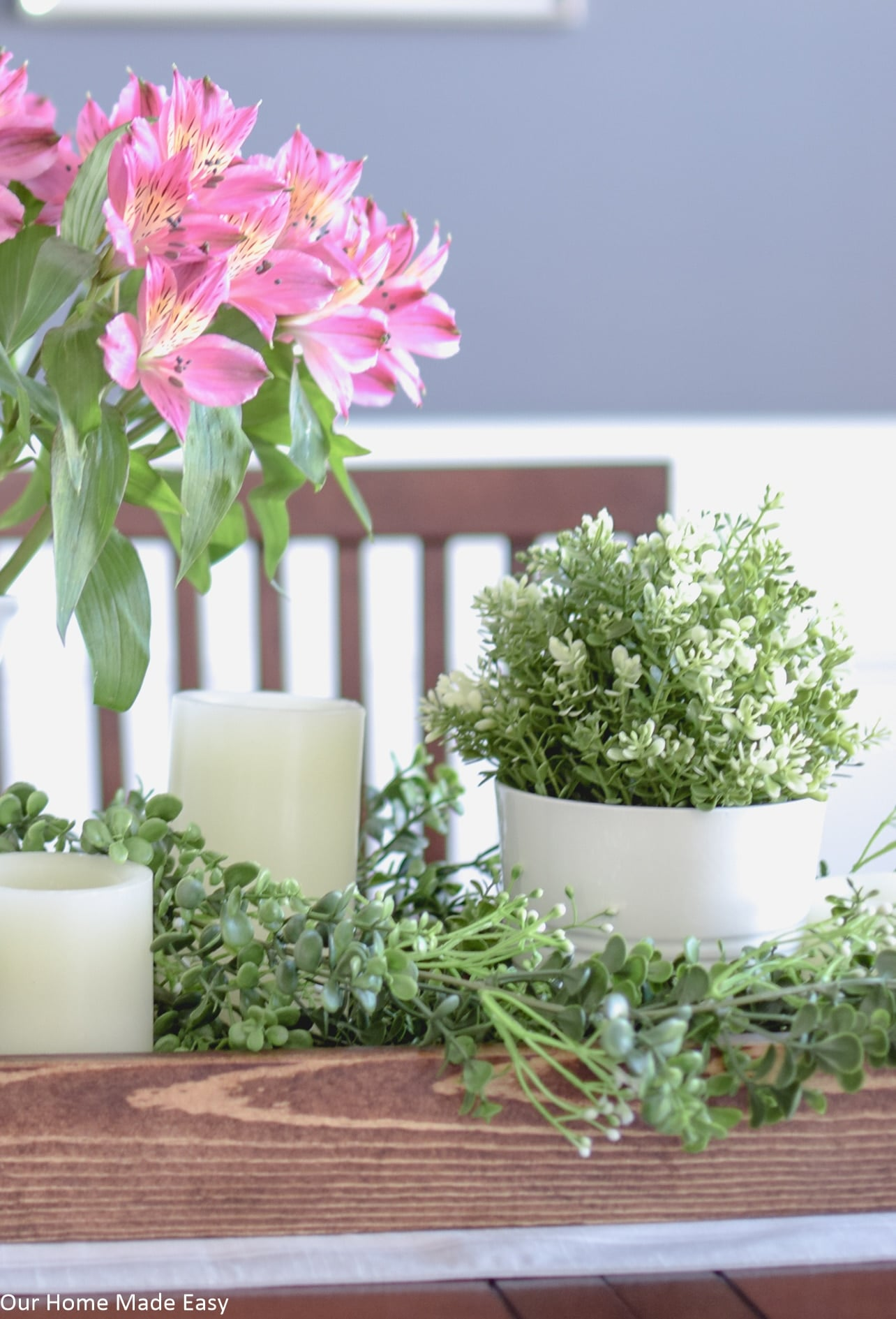 This easy Spring centerpiece is bright and colorful and brings a freshness to your home decor