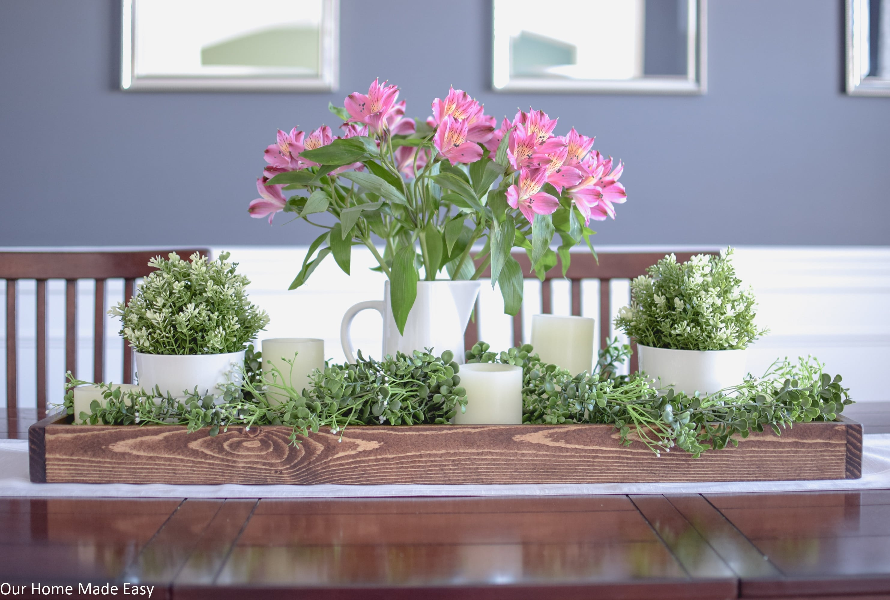 This bright and colorful Spring centerpiece is has faux flowers an greenery for a long-lasting and fresh look