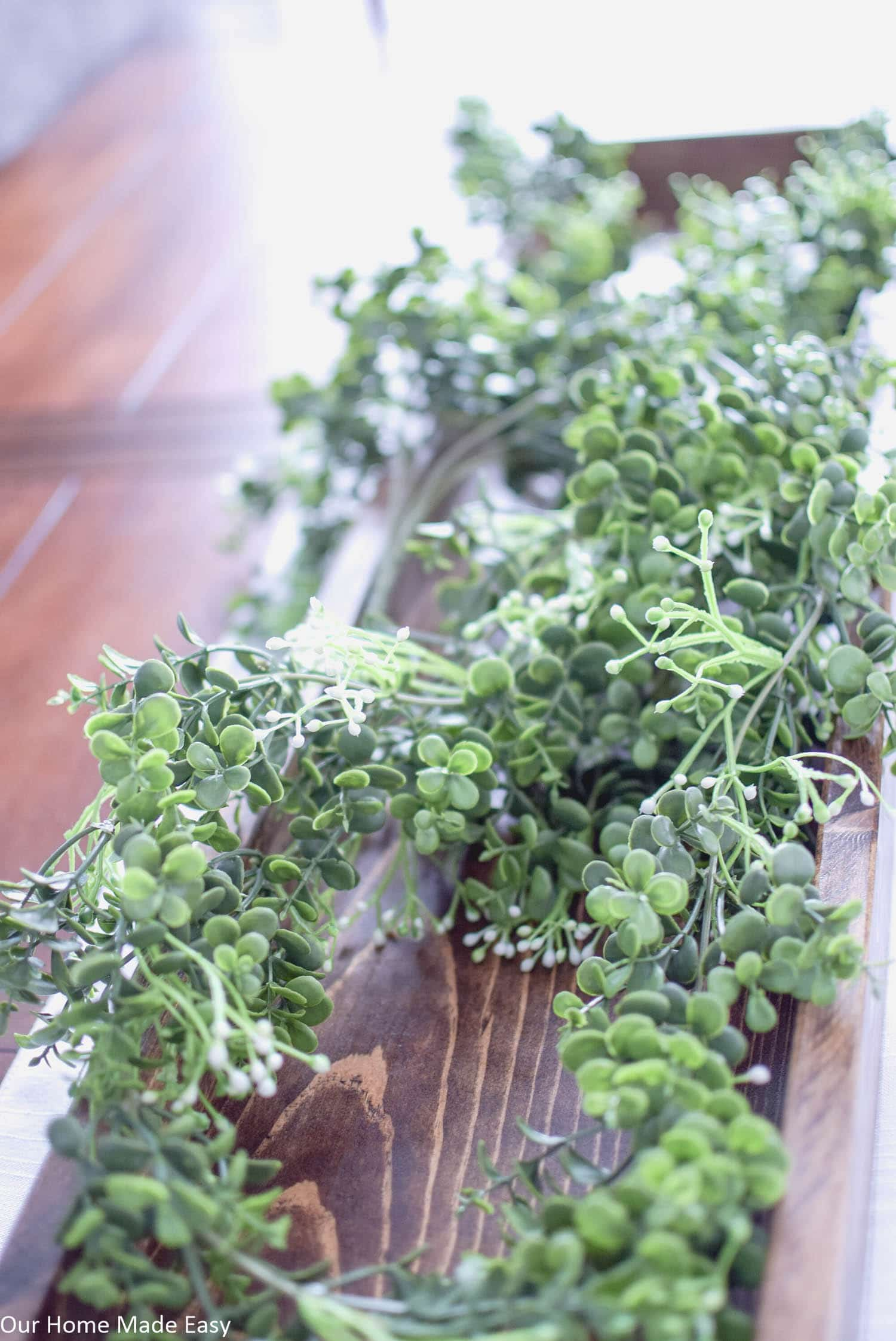 These faux green vines are perfect for a Spring centerpiece