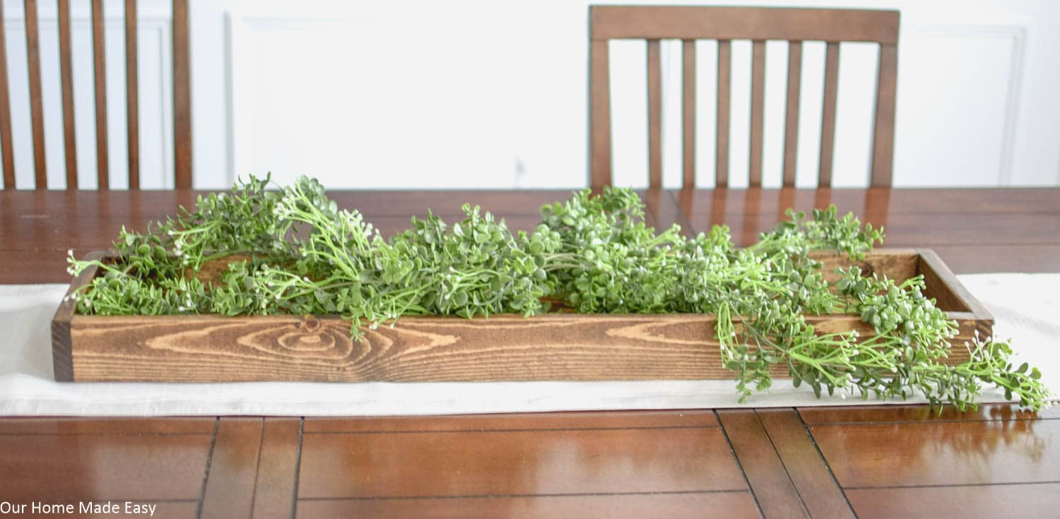 Lay down a base of faux greenery like these simple vines for your Spring centerpiece
