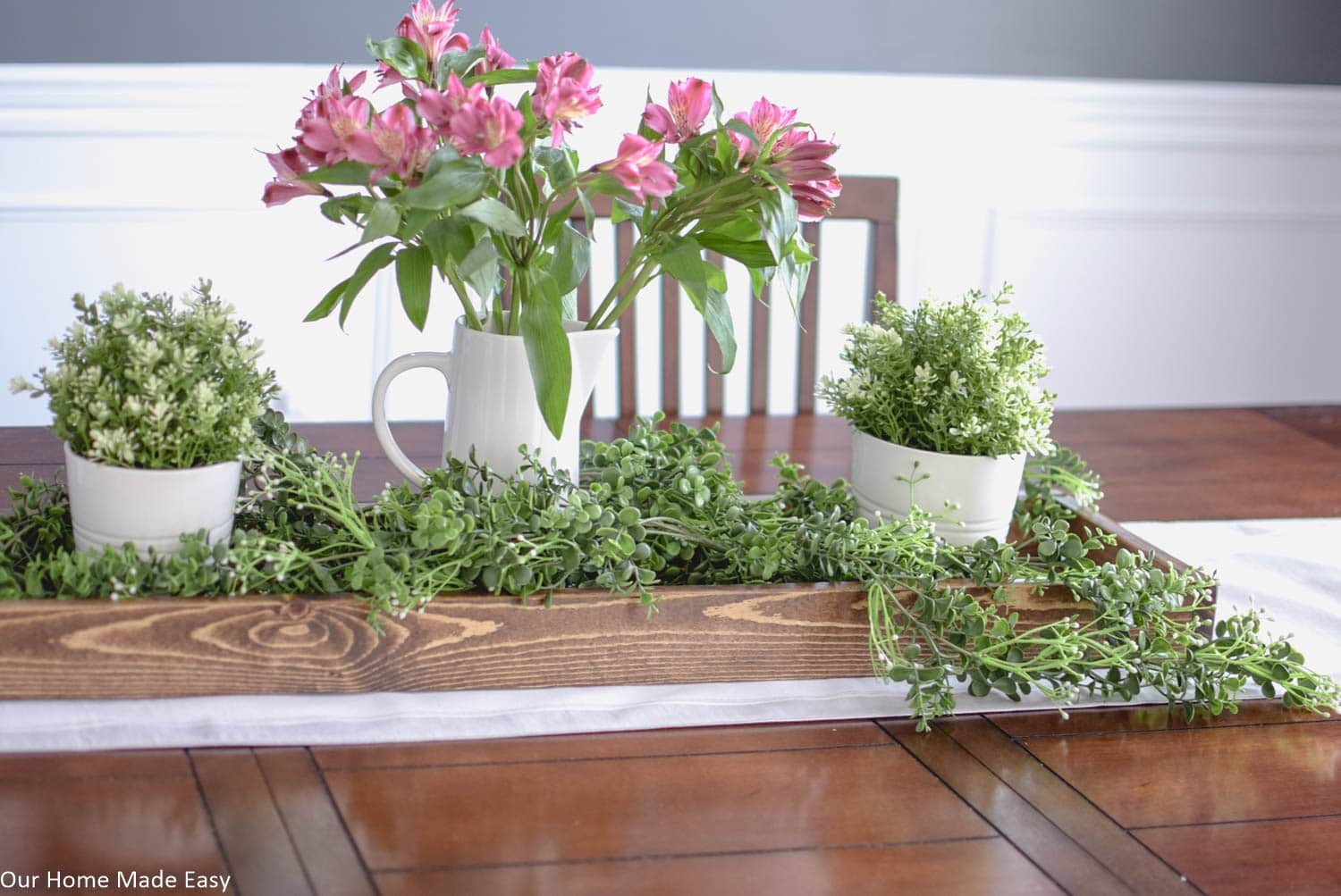 Add some height in your Spring centerpiece with vases. I chose simple white porcelain vases