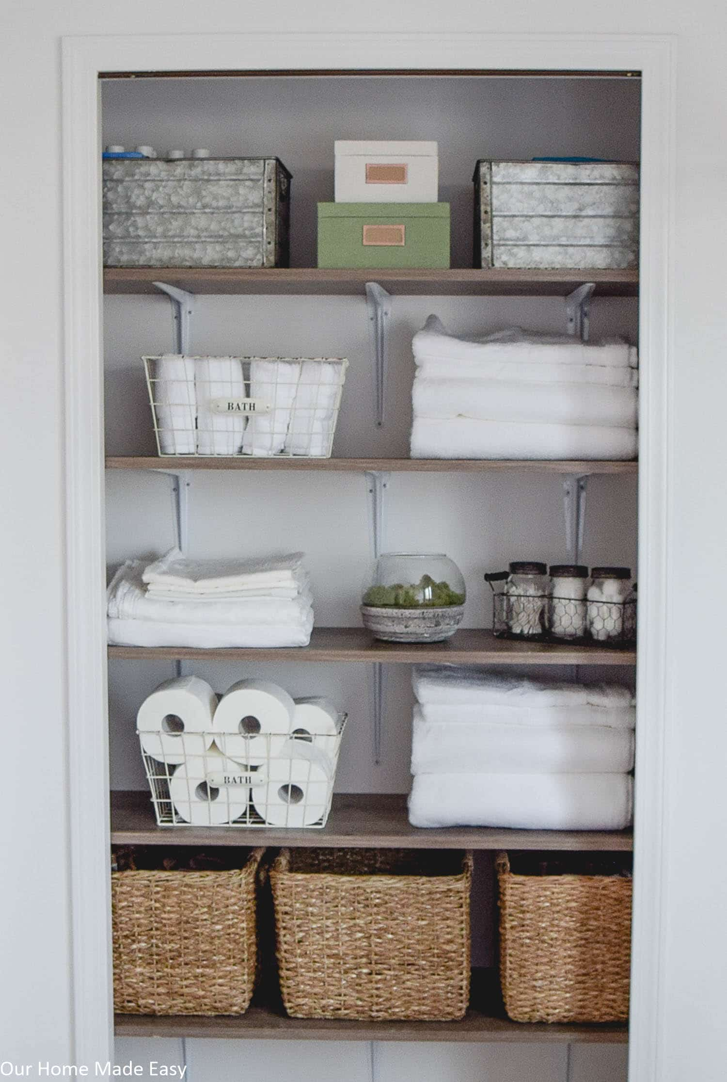 A DIY but custom shelving system for a linen closet makeover. Check out the organizational ideas and how to DIY your own shelves!