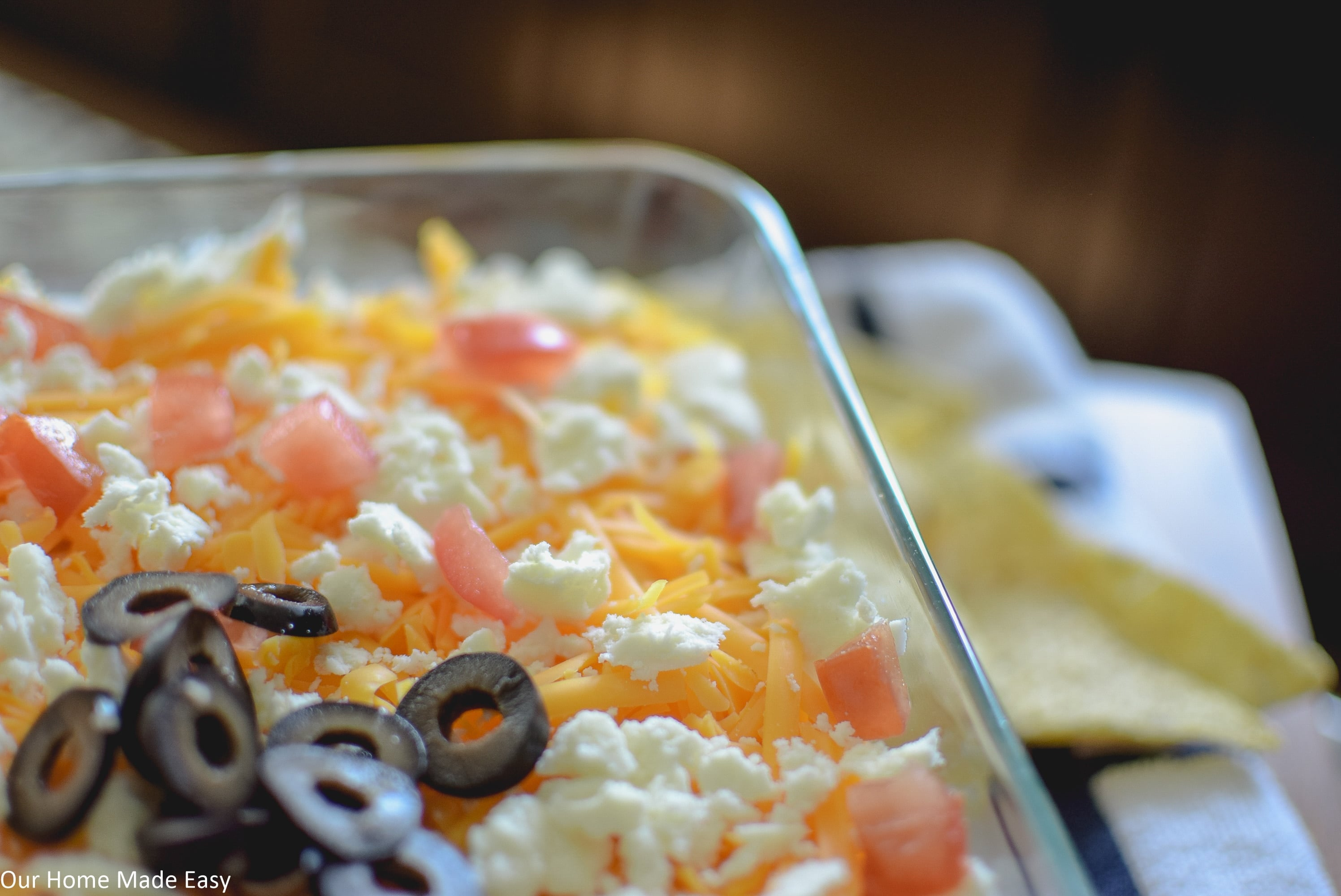 deliciously easy 7 layer taco dip is perfect for a party