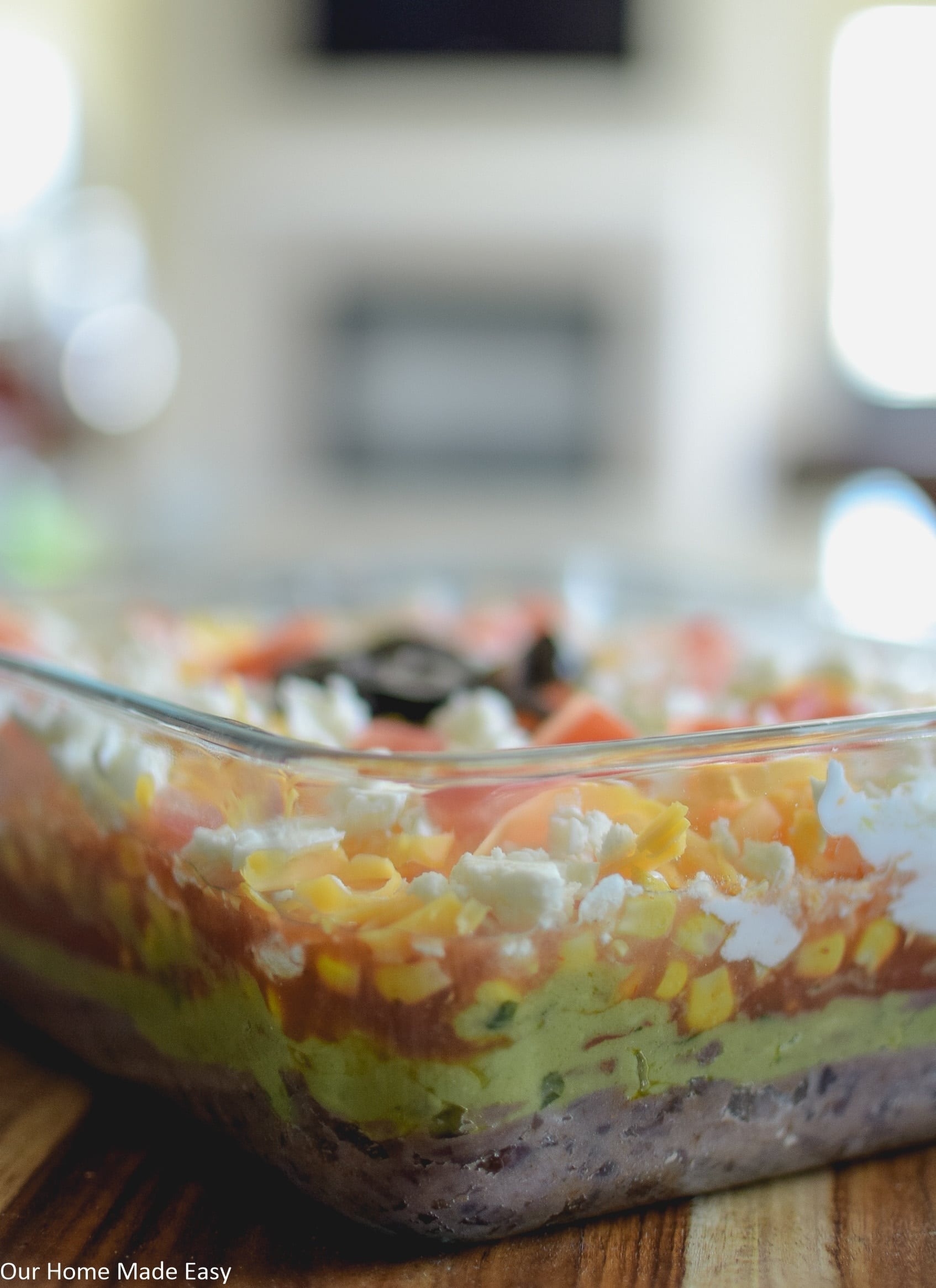 a quick 7 layer taco dip is a recipe that everyone should have on hand