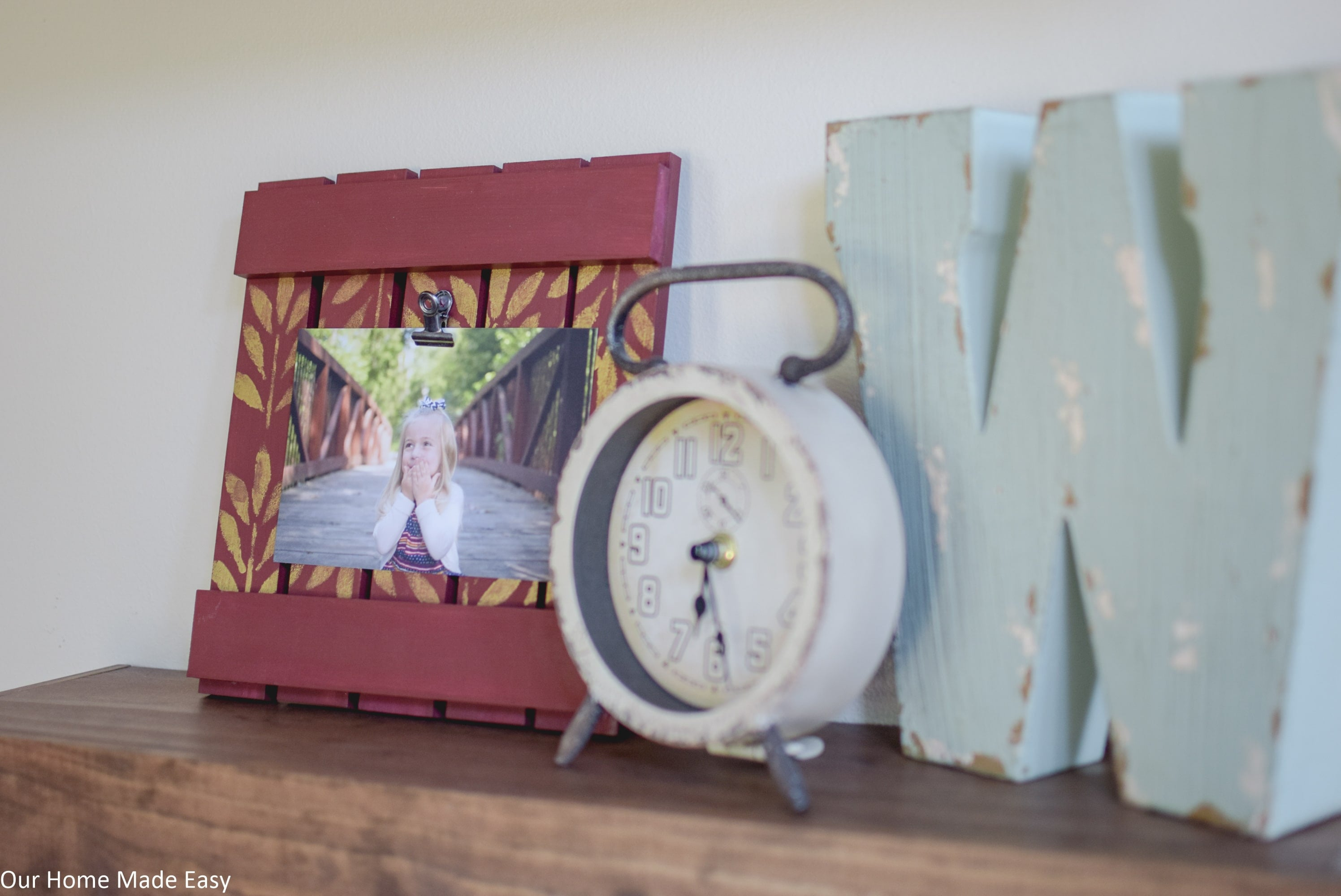 This simple DIY picture frame is made from reclaimed wood and will look perfect on your mantle