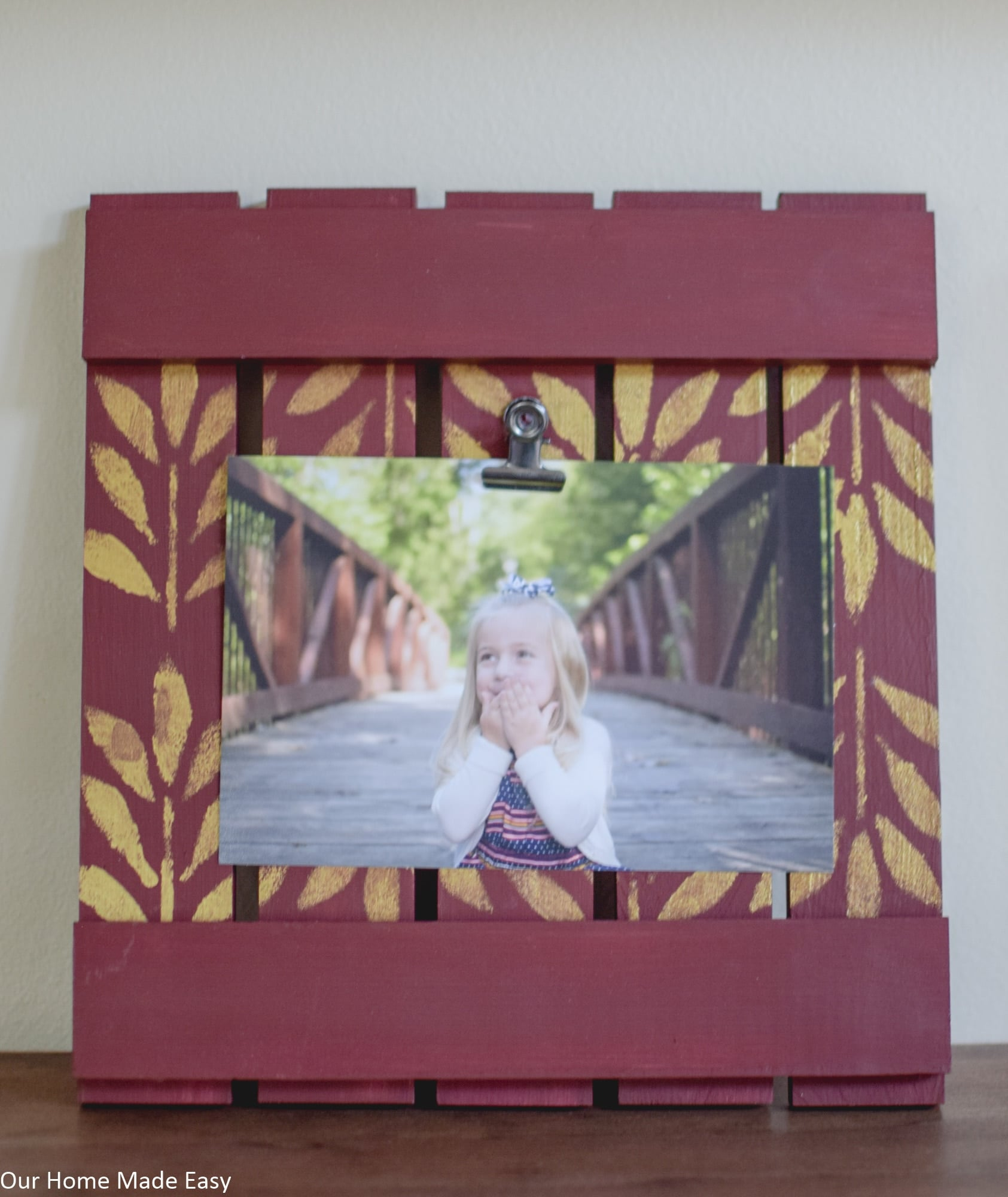 Complete the wood picture frame by attaching a picture clip to hold the picture