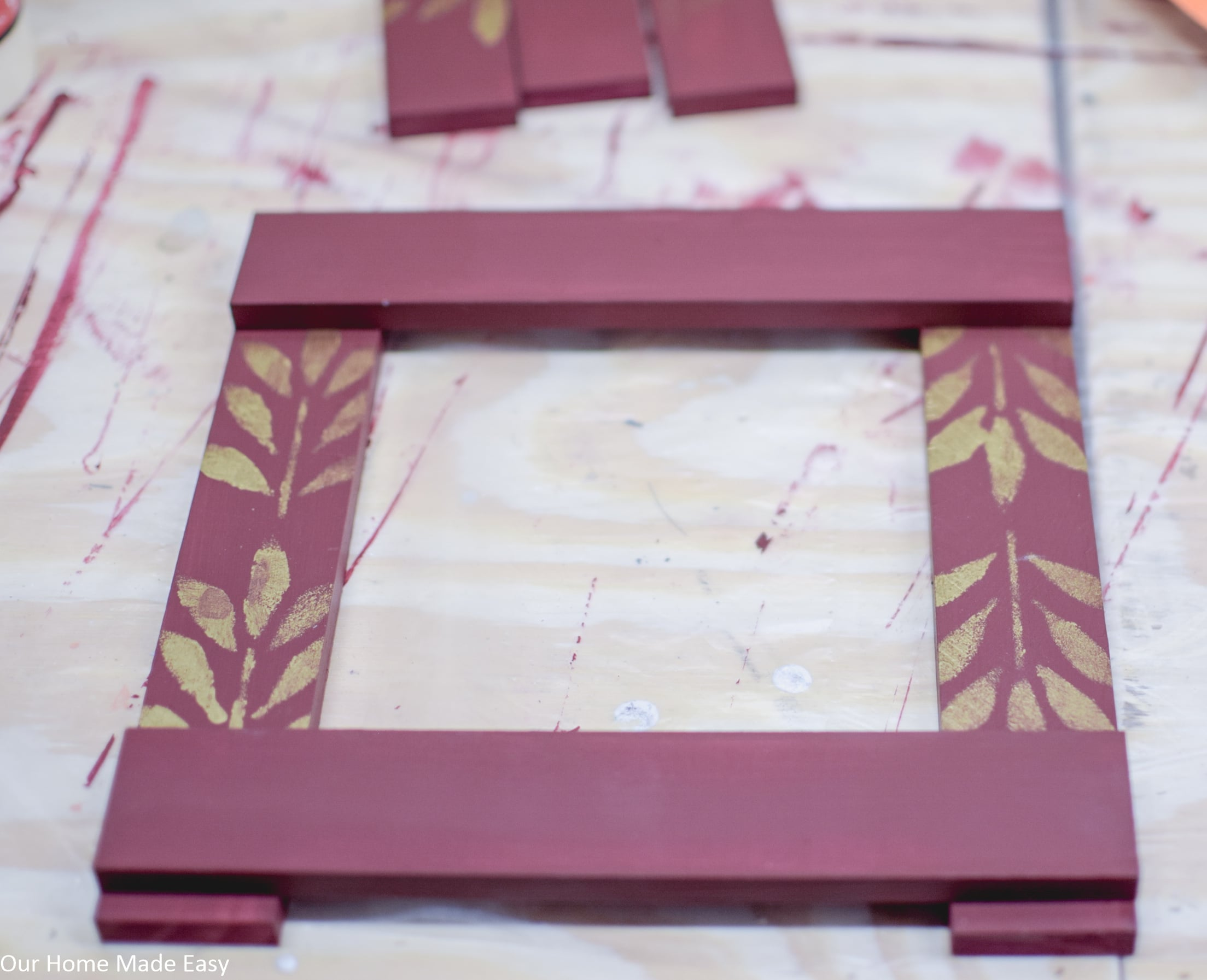 Begin gluing together the wooden slats to form the picture frame