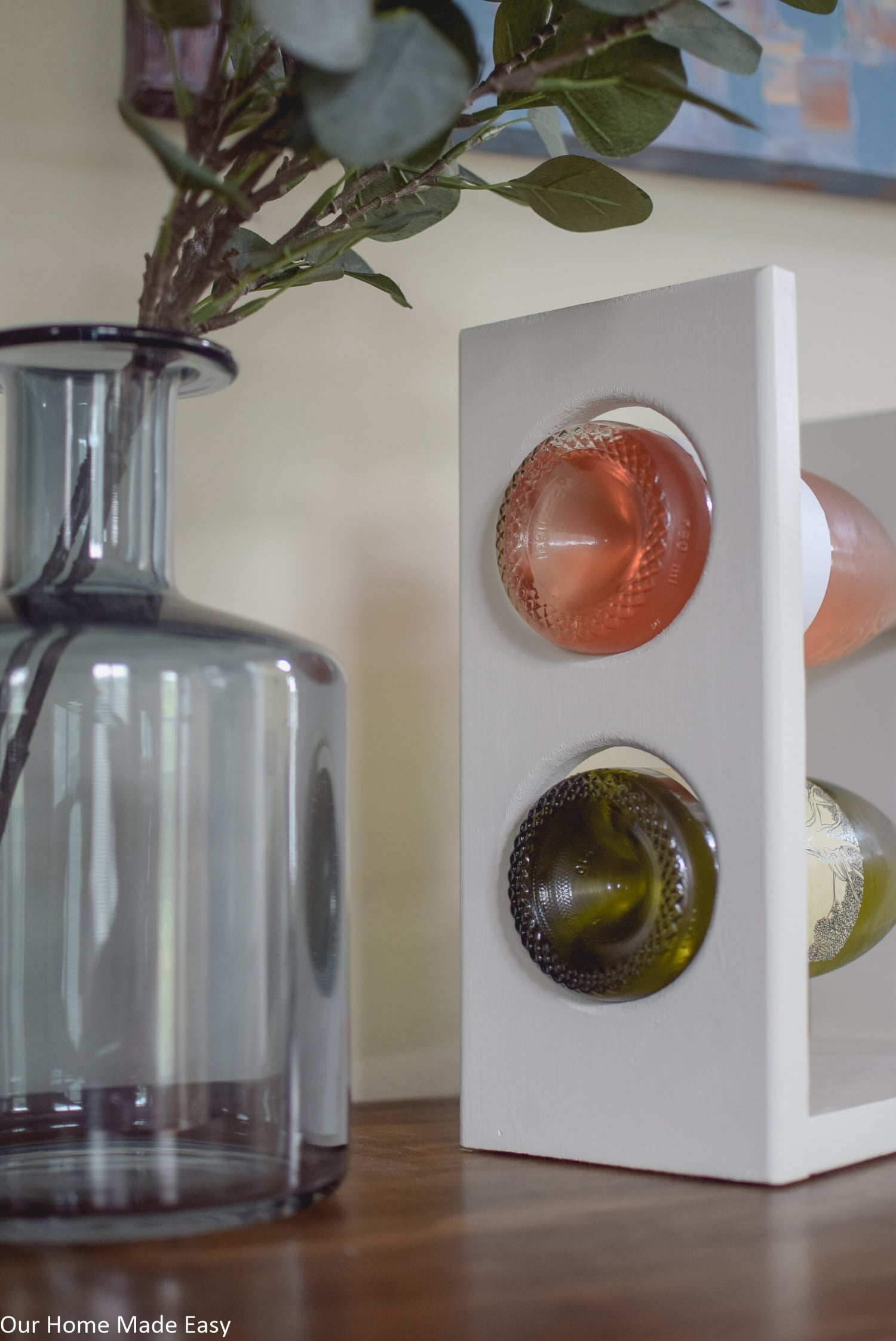 This DIY wine rack easily fits two average size bottles of wine