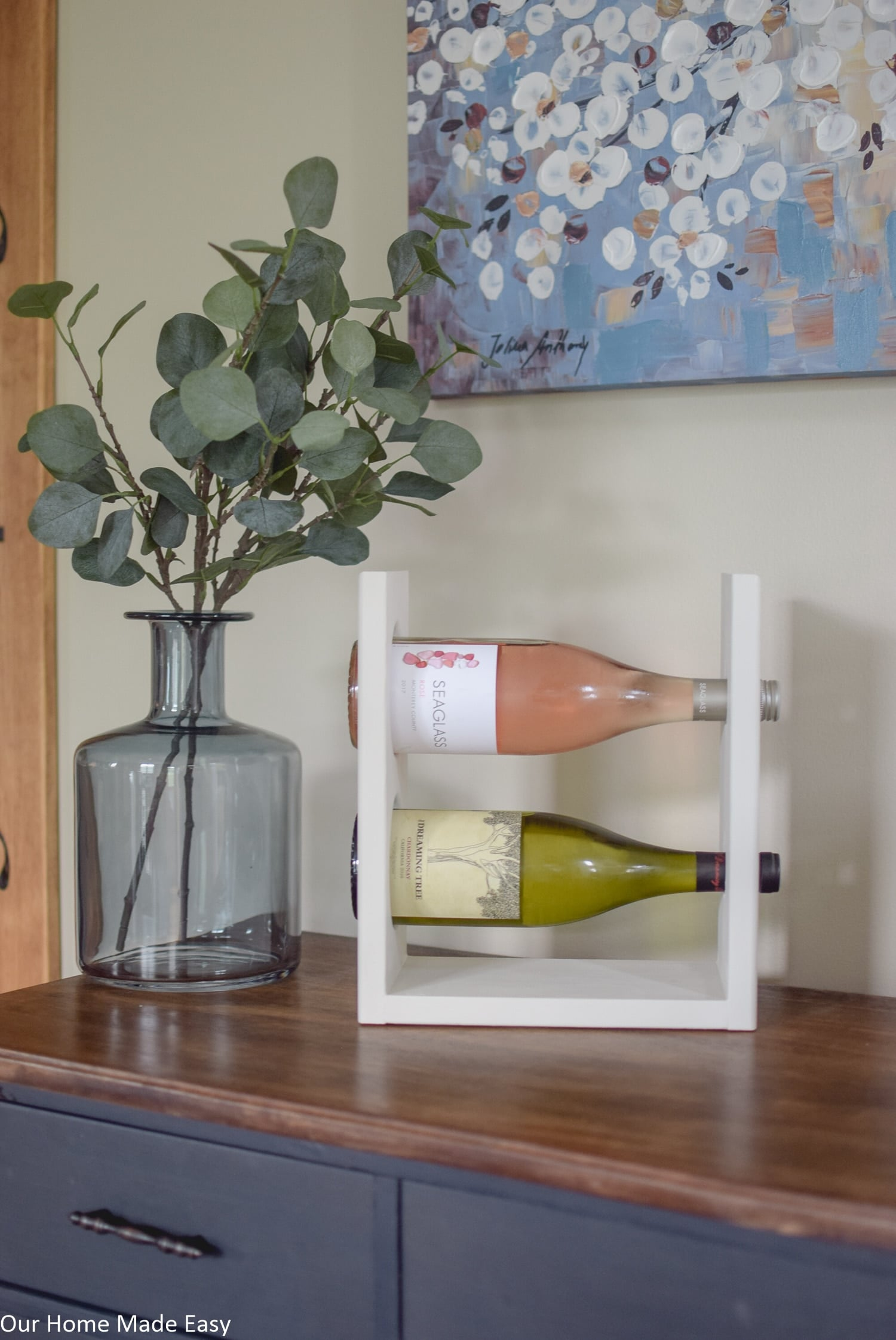This simple DIY wine racks holds two average size bottles of wine - perfect for a couple's dinner
