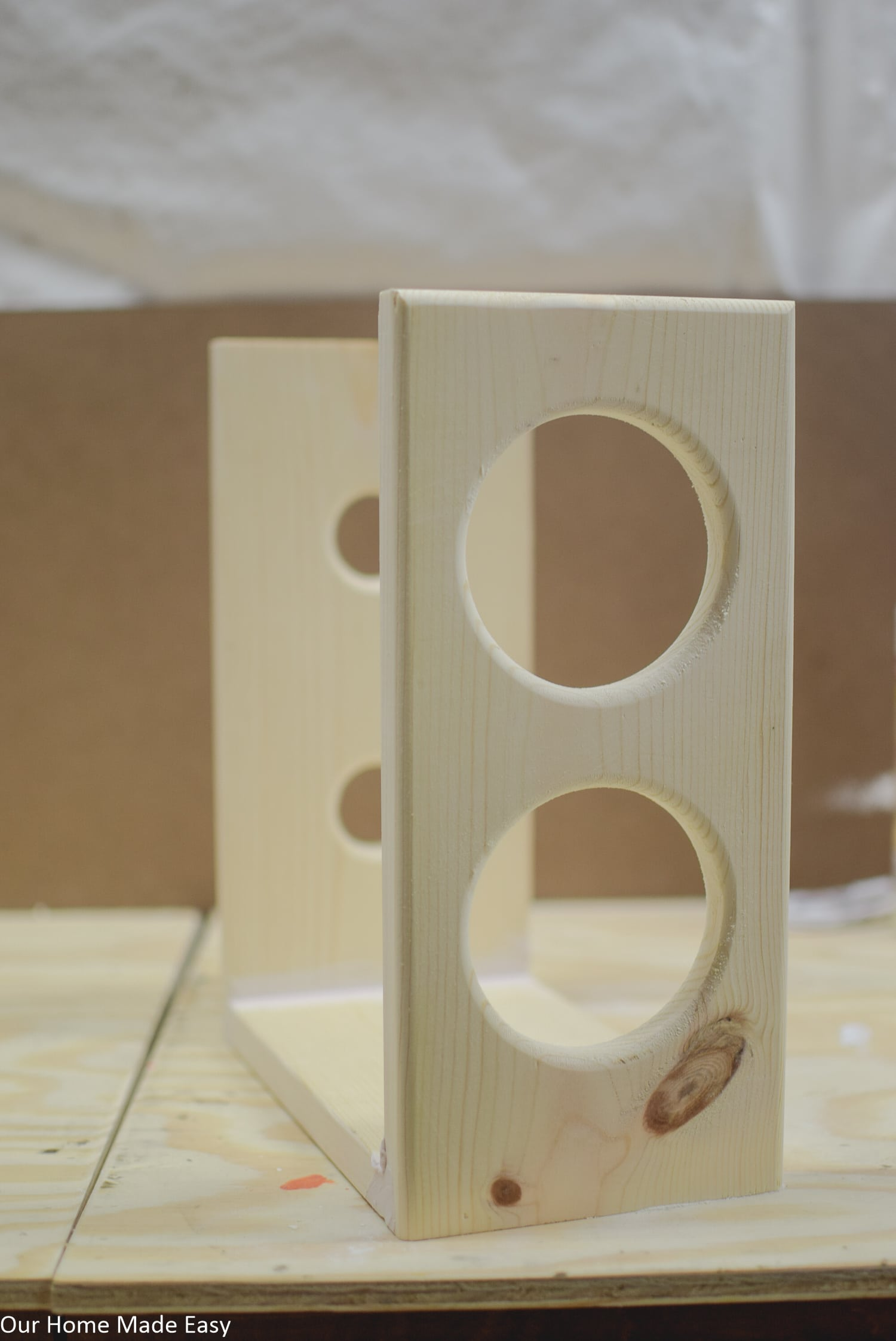 Attach the two boards to the wine rack base, making sure the smaller holes and larger holes are even