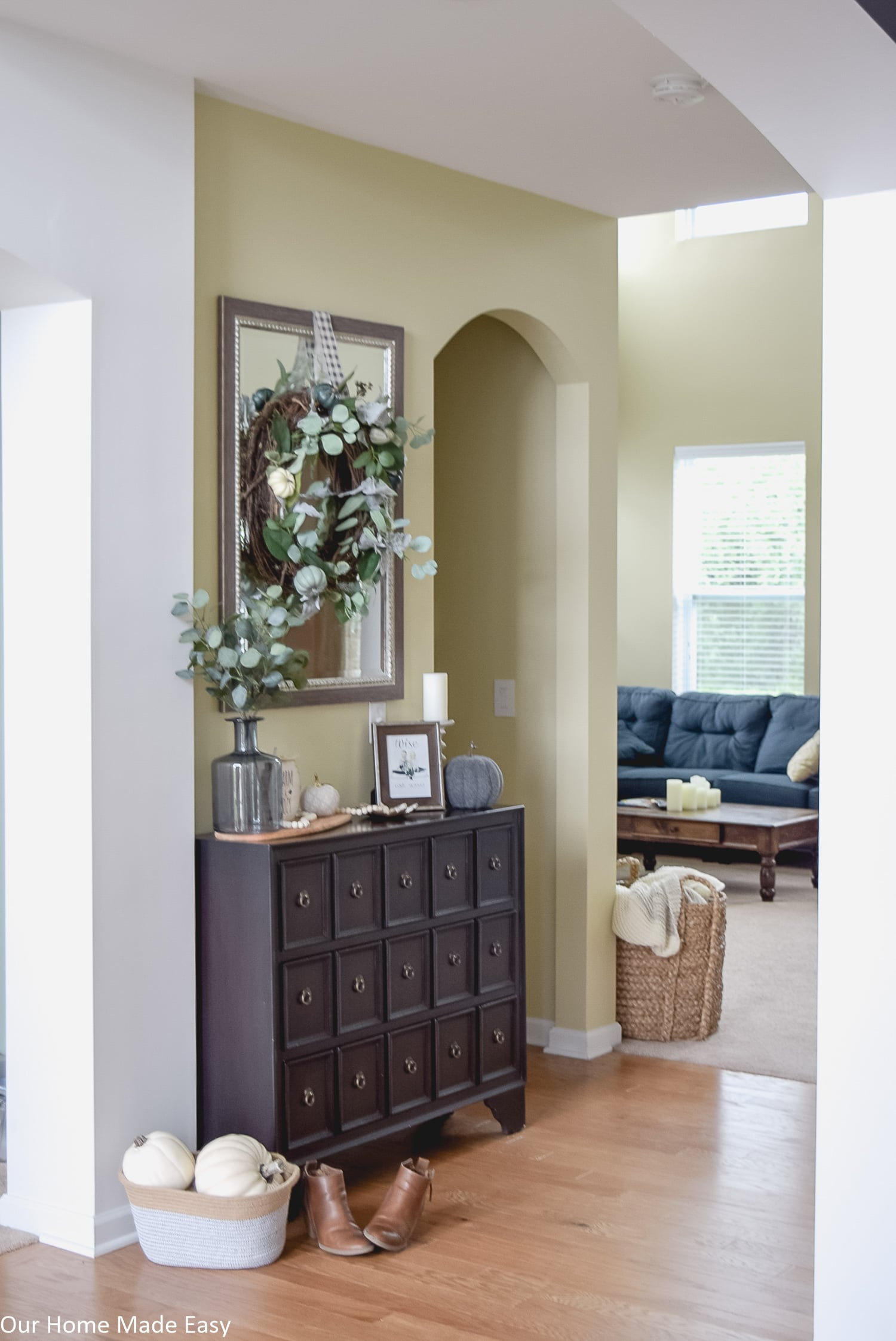 Subtle touches of fall decor around your home, like pumpkins and floral arrangements are easy ways to decorate for fall