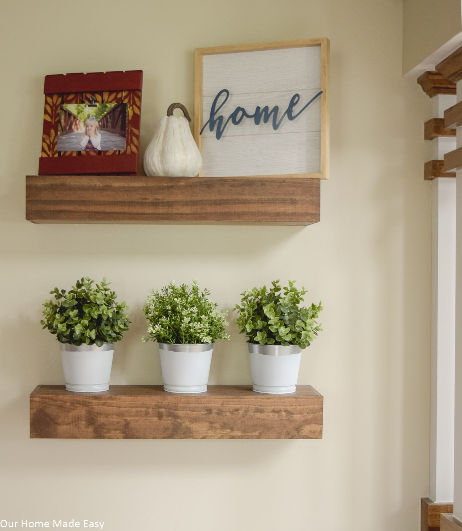 These paint-dipped metal planters are a simple addition to our home's neutral decor