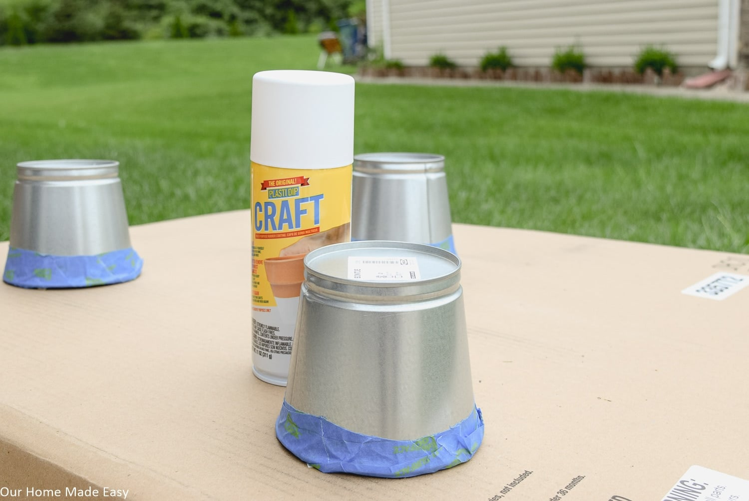 How it's time to use Plasti Dip spray paint to give these mental planters a paint-dipped effect