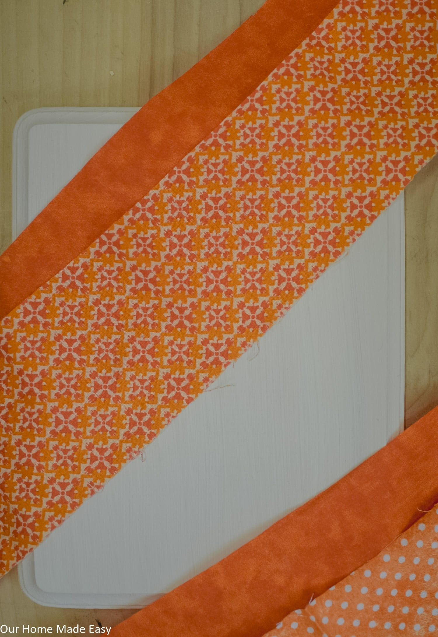 This simple fall fabric is perfect for making this fabric pumpkin craft