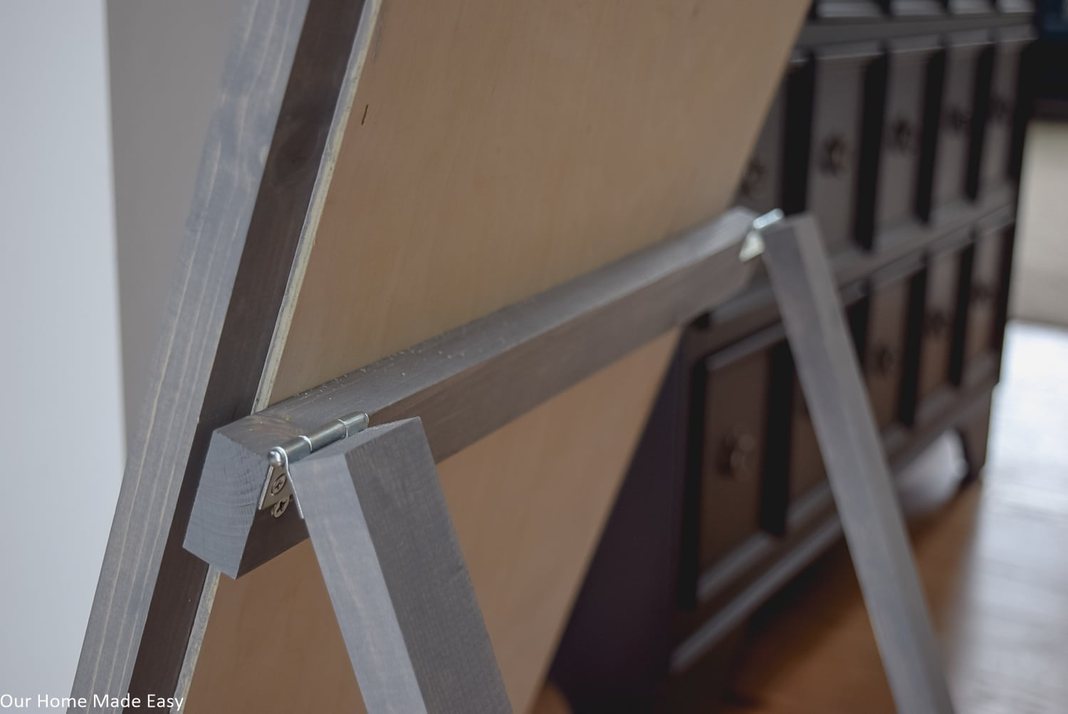 These support legs attached with hinges will make standing this sign up on your front porch easy and convenient.
