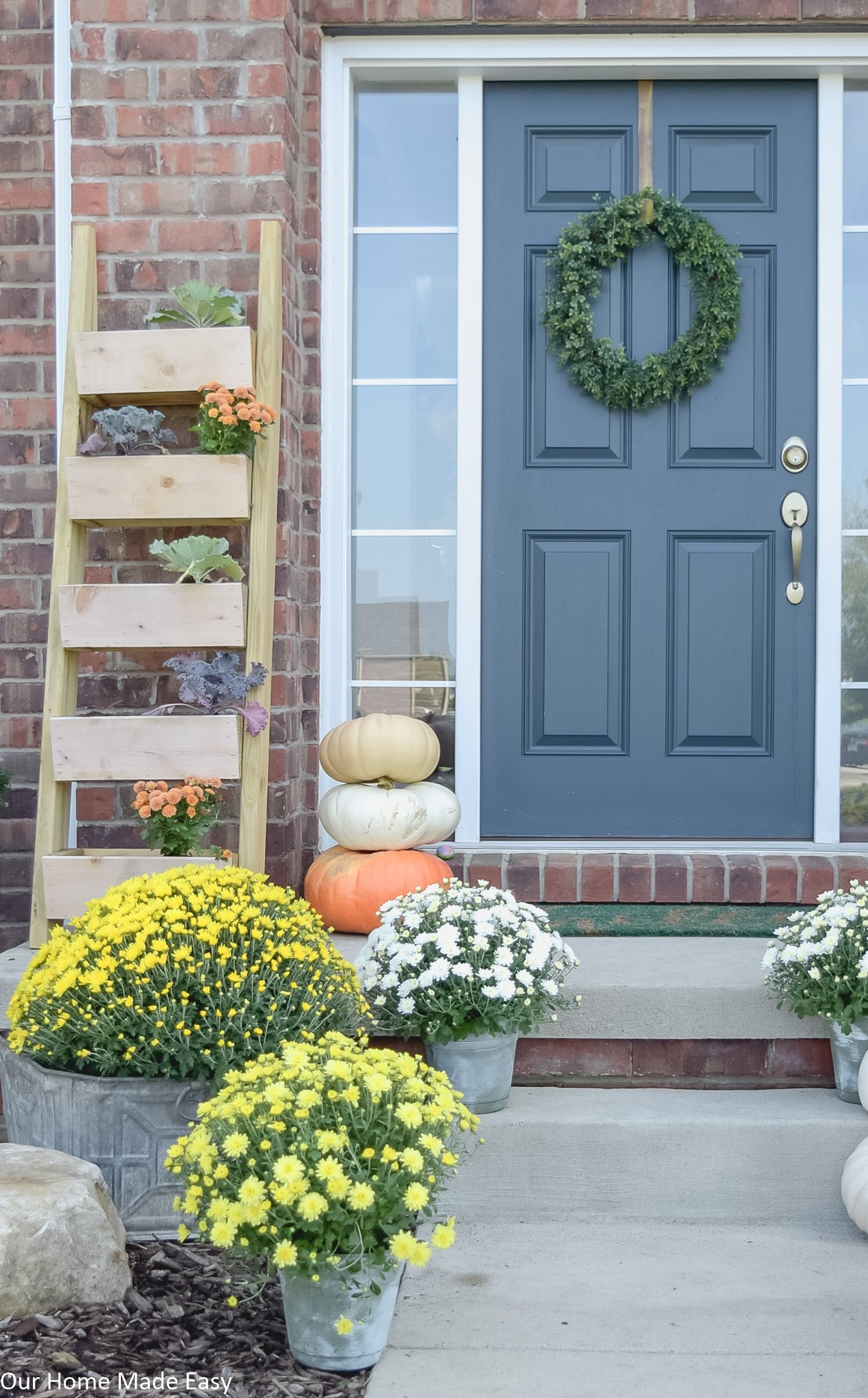 bright colored potted mums are an easy way to add a fresh, fall touch to your front porch