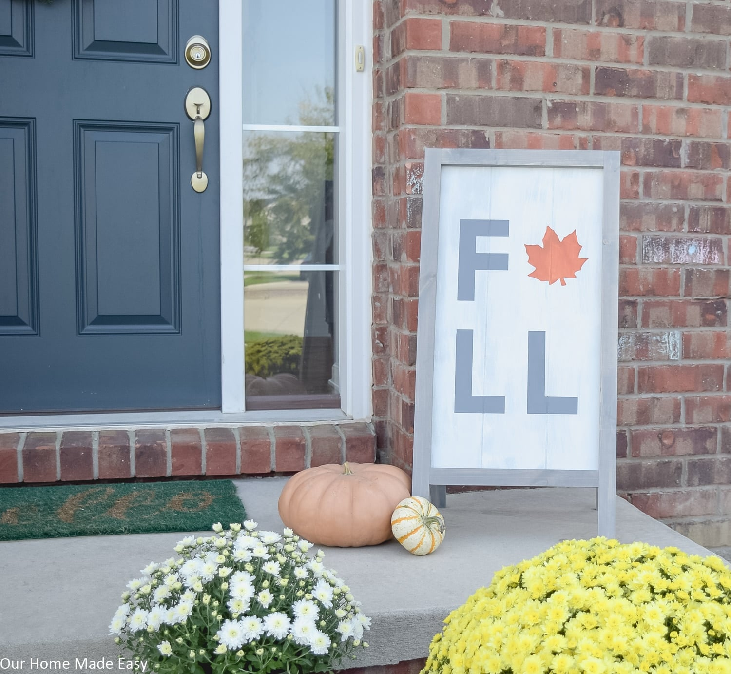 Yellow and white mums add color to this fall front porch