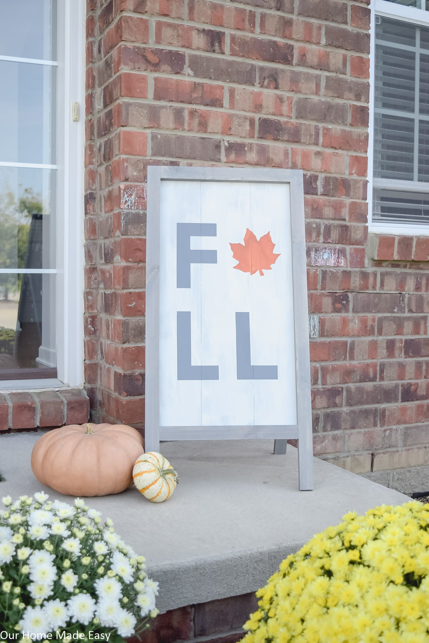 this fall harvest sign is a simple DIY project that is perfect for a fall decorated front porch