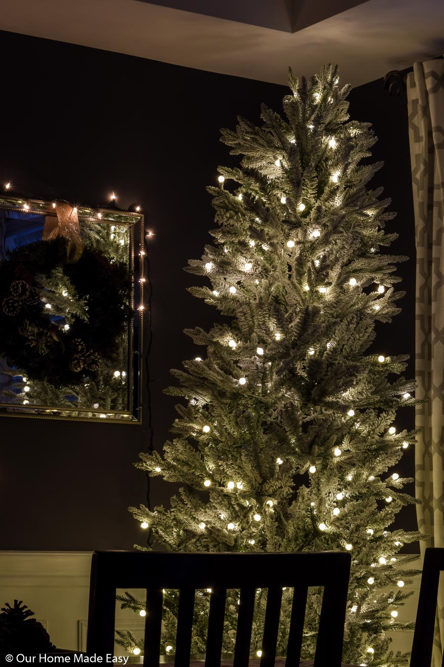 I love the simplicity of this all-white frosted branch Christmas tree with simple white lights