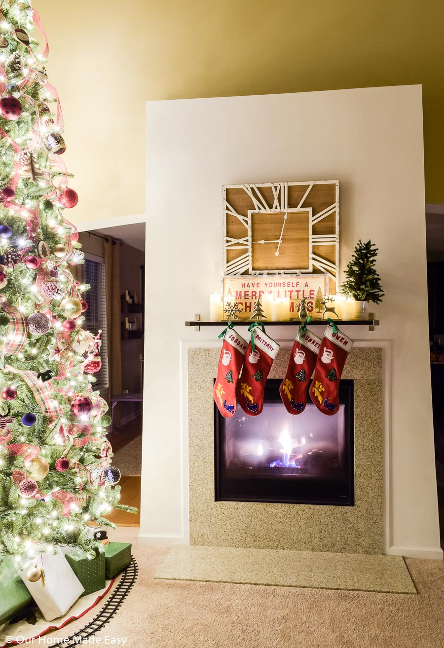 """Our fireplace """"mantle"""" is a simple DIY project--a single bookshelf from Jordan's college days!"""