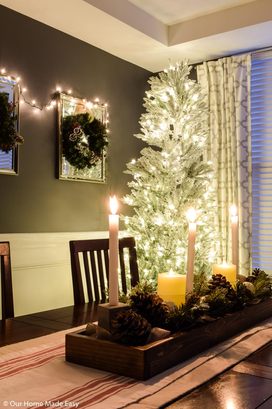 This all-white frosted Christmas tree brightens up our dining room
