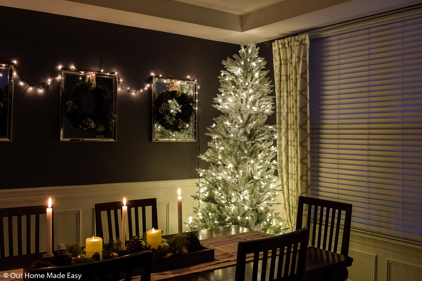 This white frosted branch Christmas tree is our dining room Christmas decoration, adorned in simple white Christmas lights