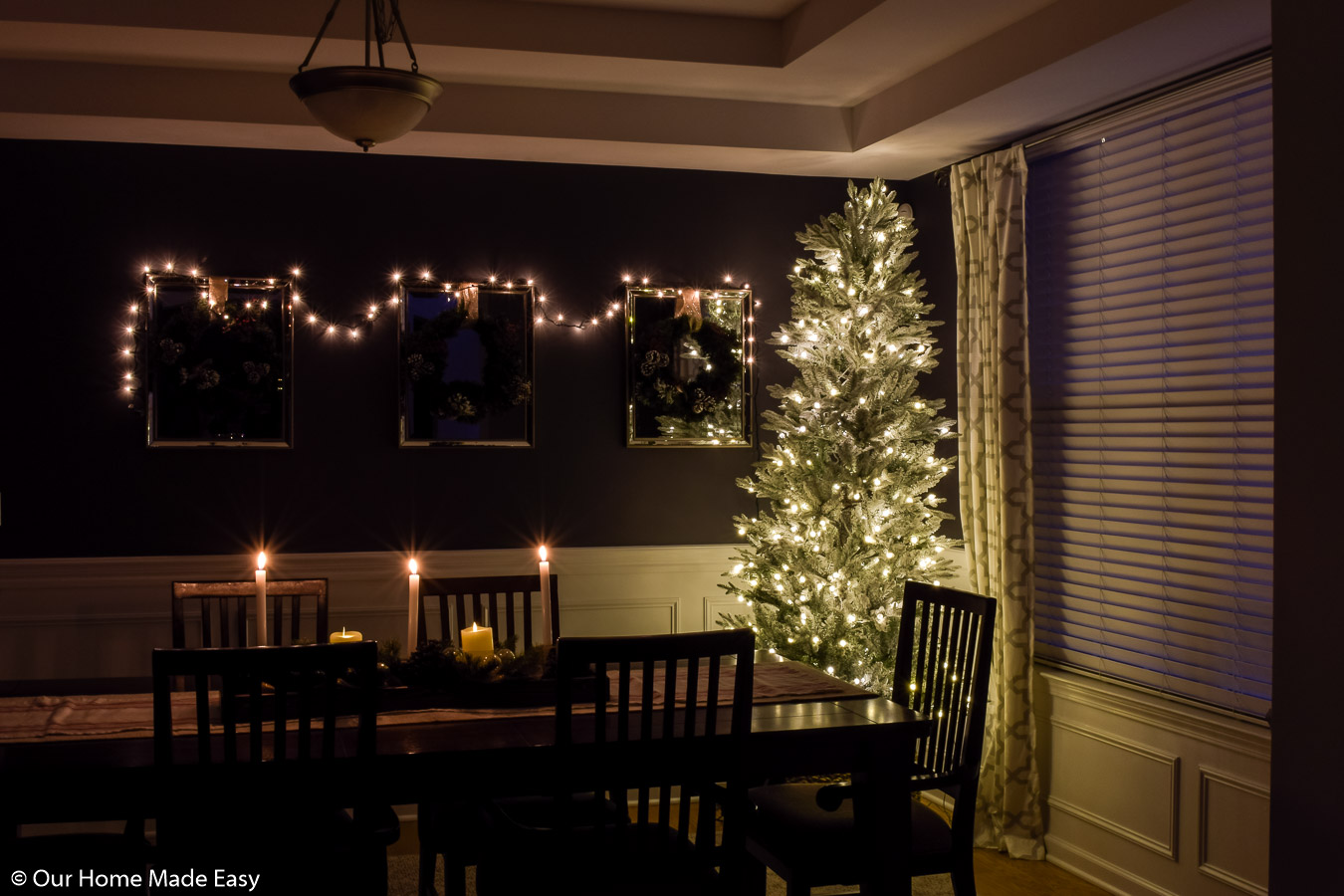 Our dining room Christmas tree is simple and bright, with clean white lights and no ornaments