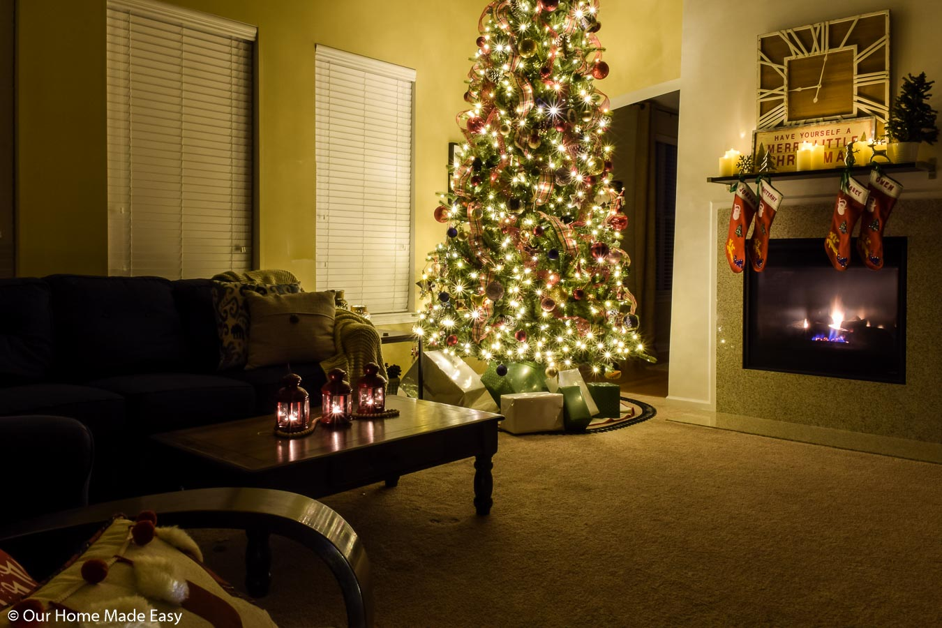 Our 12-foot Christmas tree owns our living room space with bright lights and festive decor