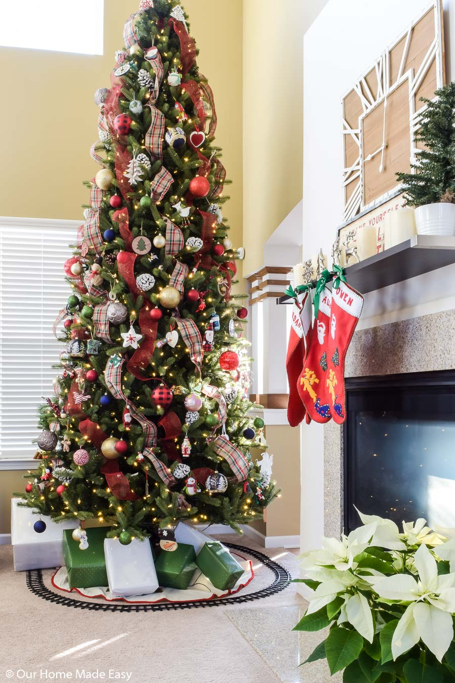 Decorate a Christmas tree with ribbon to add more fun, festive, and budget-friendly decorations to your tree