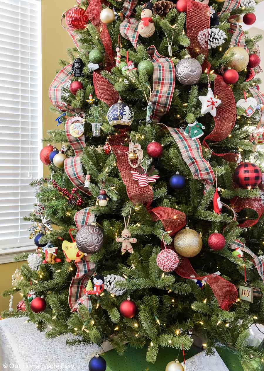 Use festive deco mesh ribbons to wrap around your tree for easy, budget-friendly decoration!