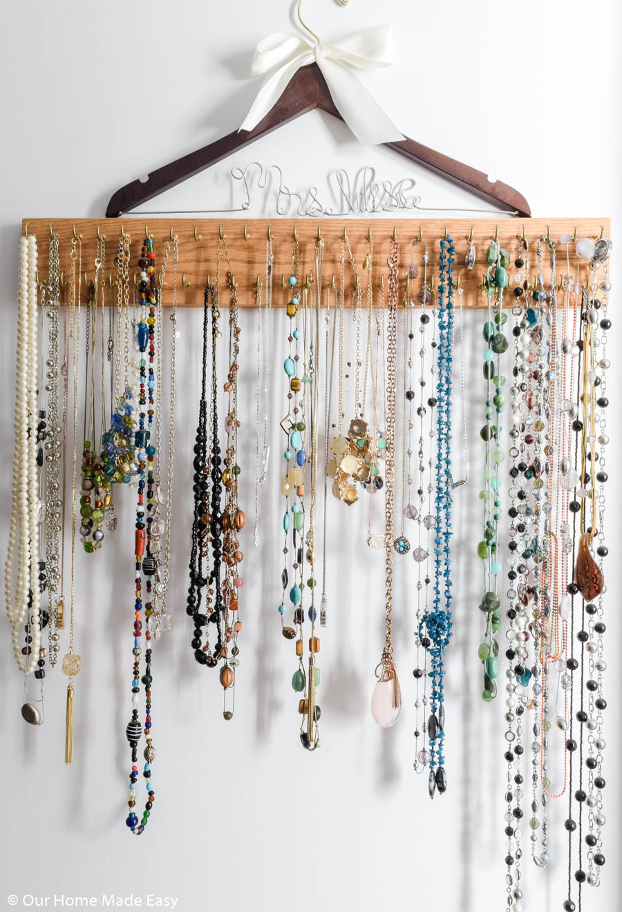 This DIY necklace rack is an easy way to organize jewelry