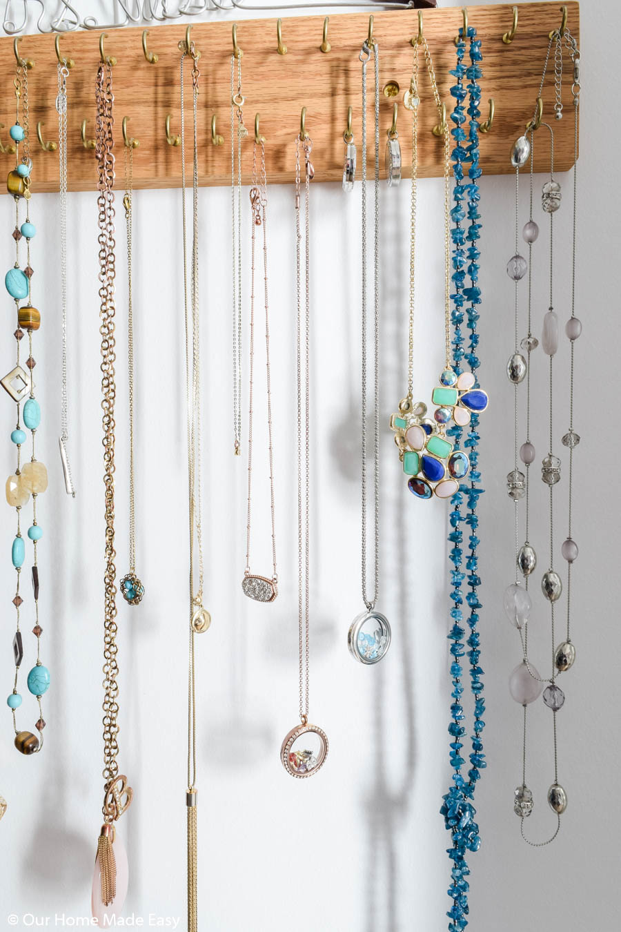 I decluttered my necklace collection and kept my favorite pieces, using this necklace rack to organize my jewelry