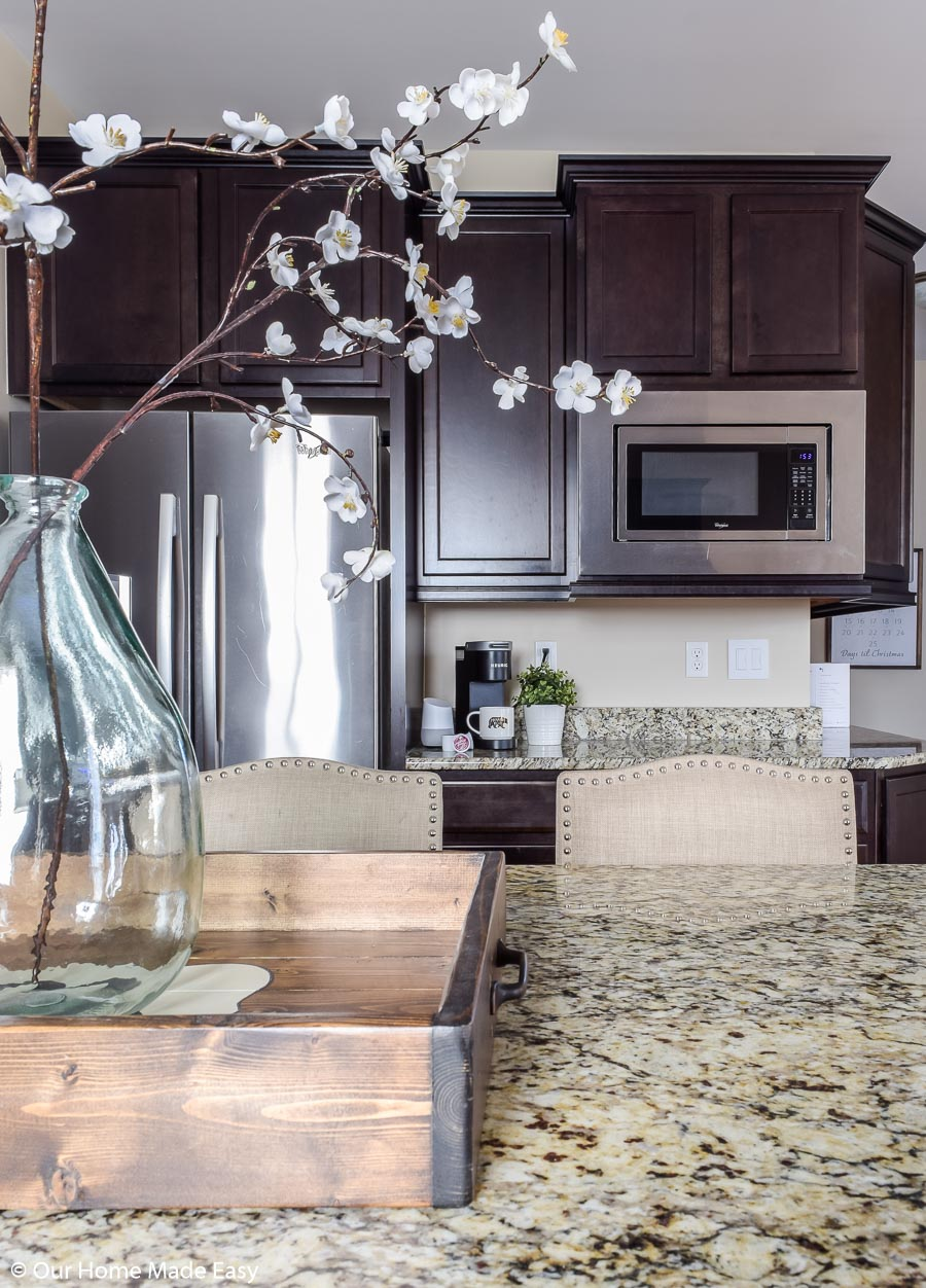 Make large spaces like the kitchen look appealing with accents like flowers and simple decor