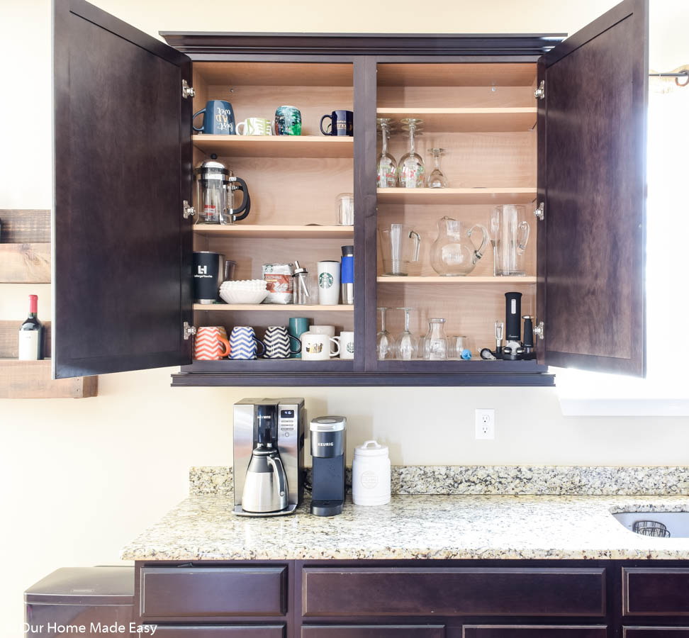 this cabinet organization is perfect for a drinking station