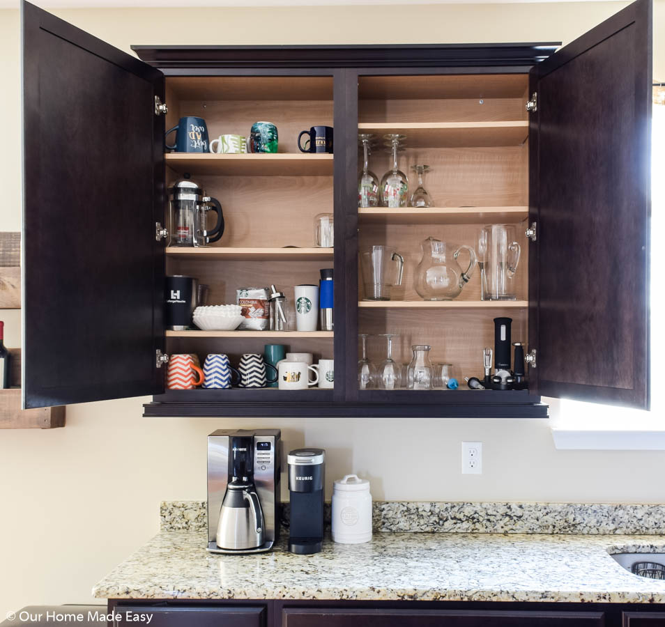 keeping your kitchen cabinets more organized is step one in decluttering your kitchen