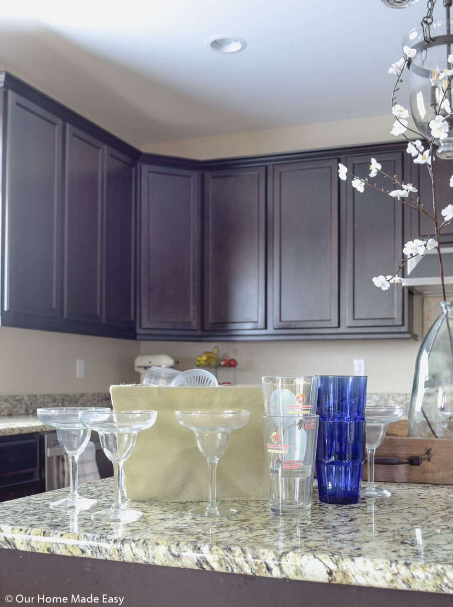 start your cabinet organizing by working through your collection of drinking glasses
