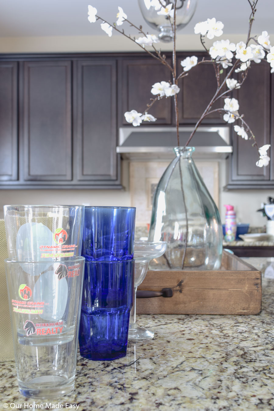 have too many glasses cluttering your cabinets? Here's how to organize your kitchen cabinets better