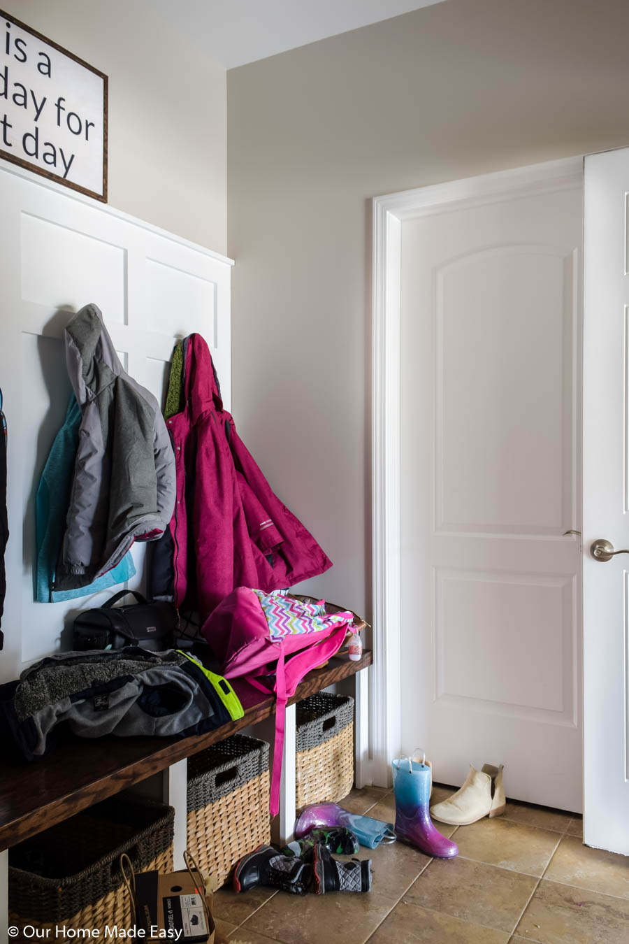 The first step to organizing your mudroom is to declutter--keep only what you need in there