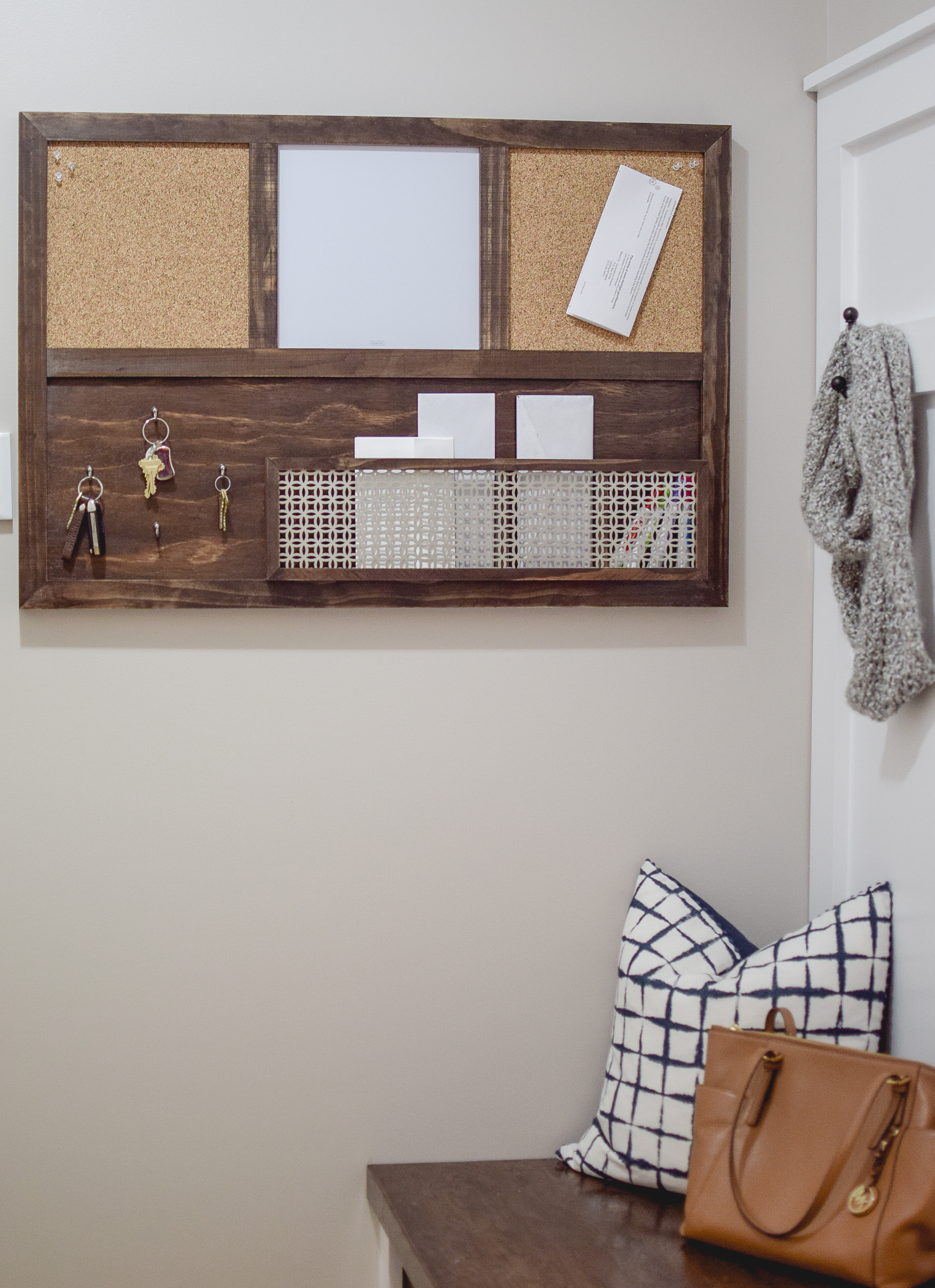 Add a key hook, mail basket, or message board in your mudroom for one-stop organization of the little things that commonly get lost.
