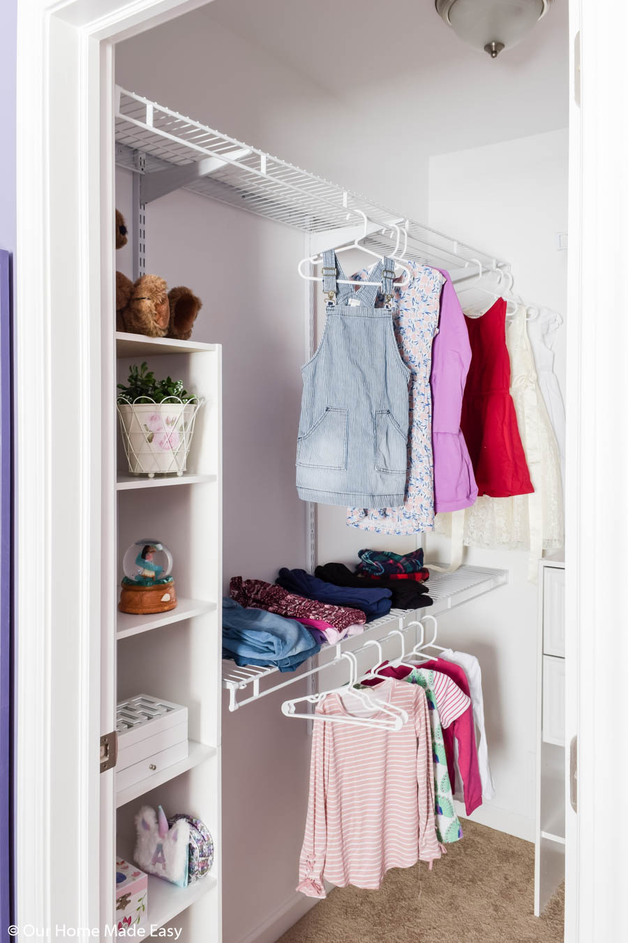 To organize our small closet, we added new shelving and storage, making the best use of small space