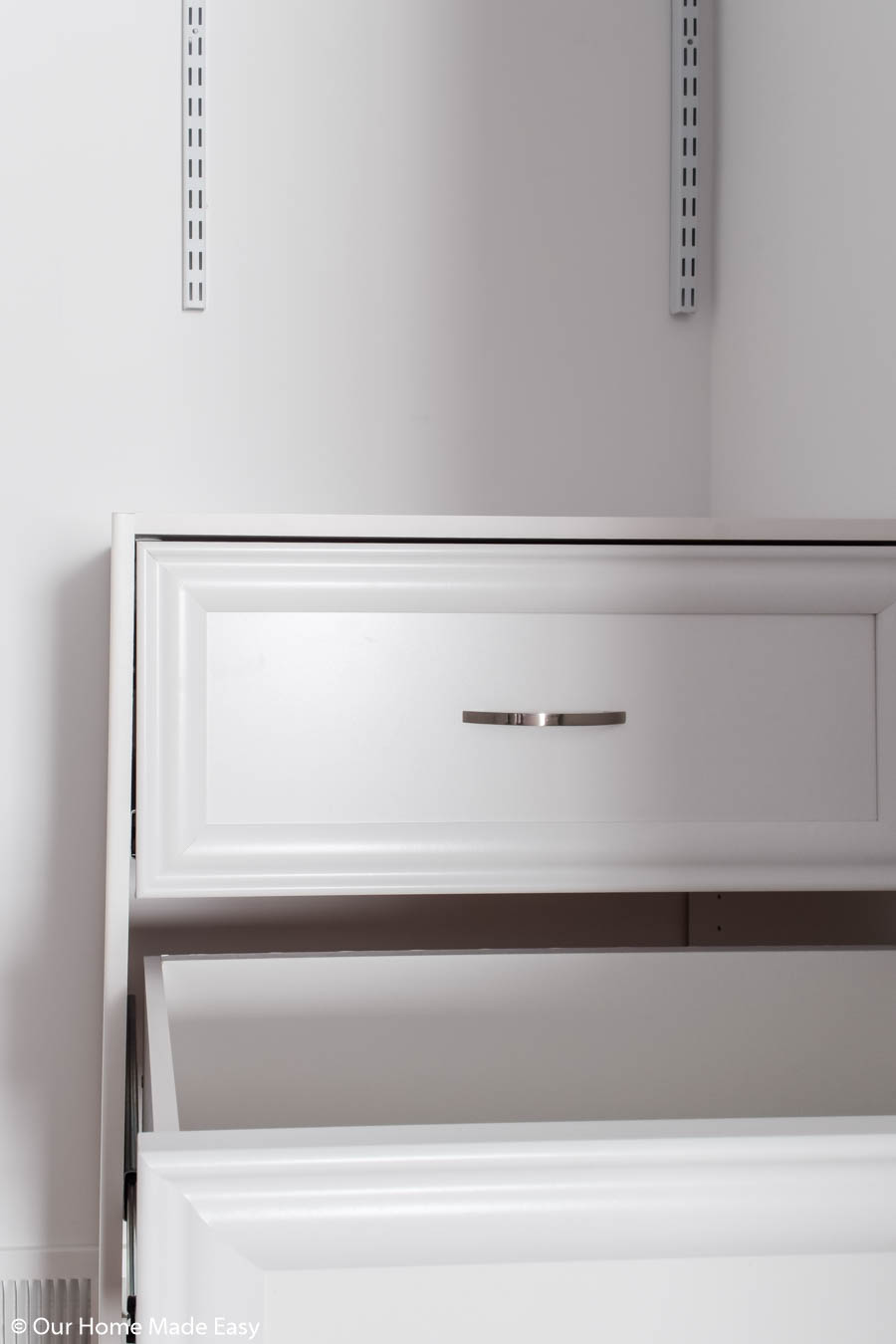 The key to organizing a small closet is to add more storage in convenient spaces
