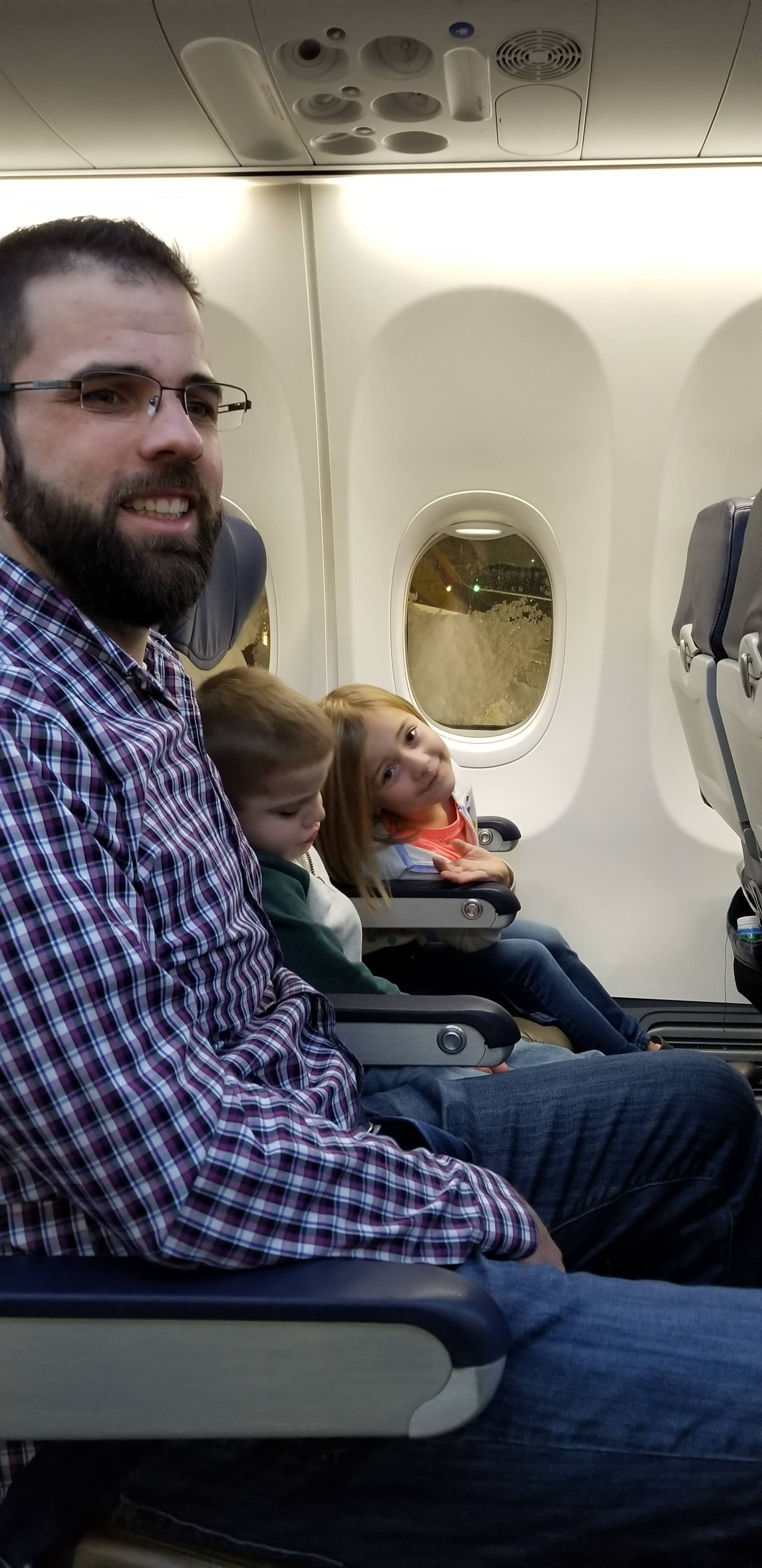 Jordan and the kids are ready for takeoff as we fly to Arizona