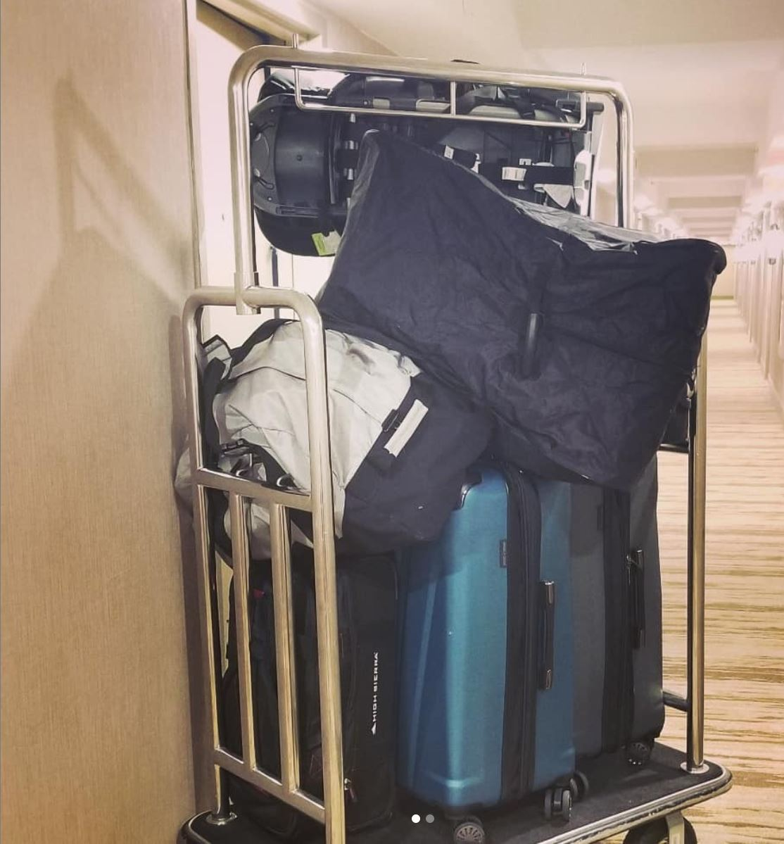 A traveling family of four with luggage at a hotel in Michigan